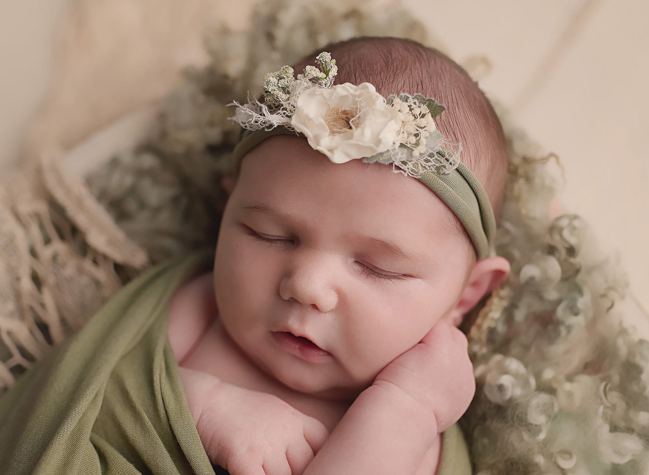 newborn baby girl in green