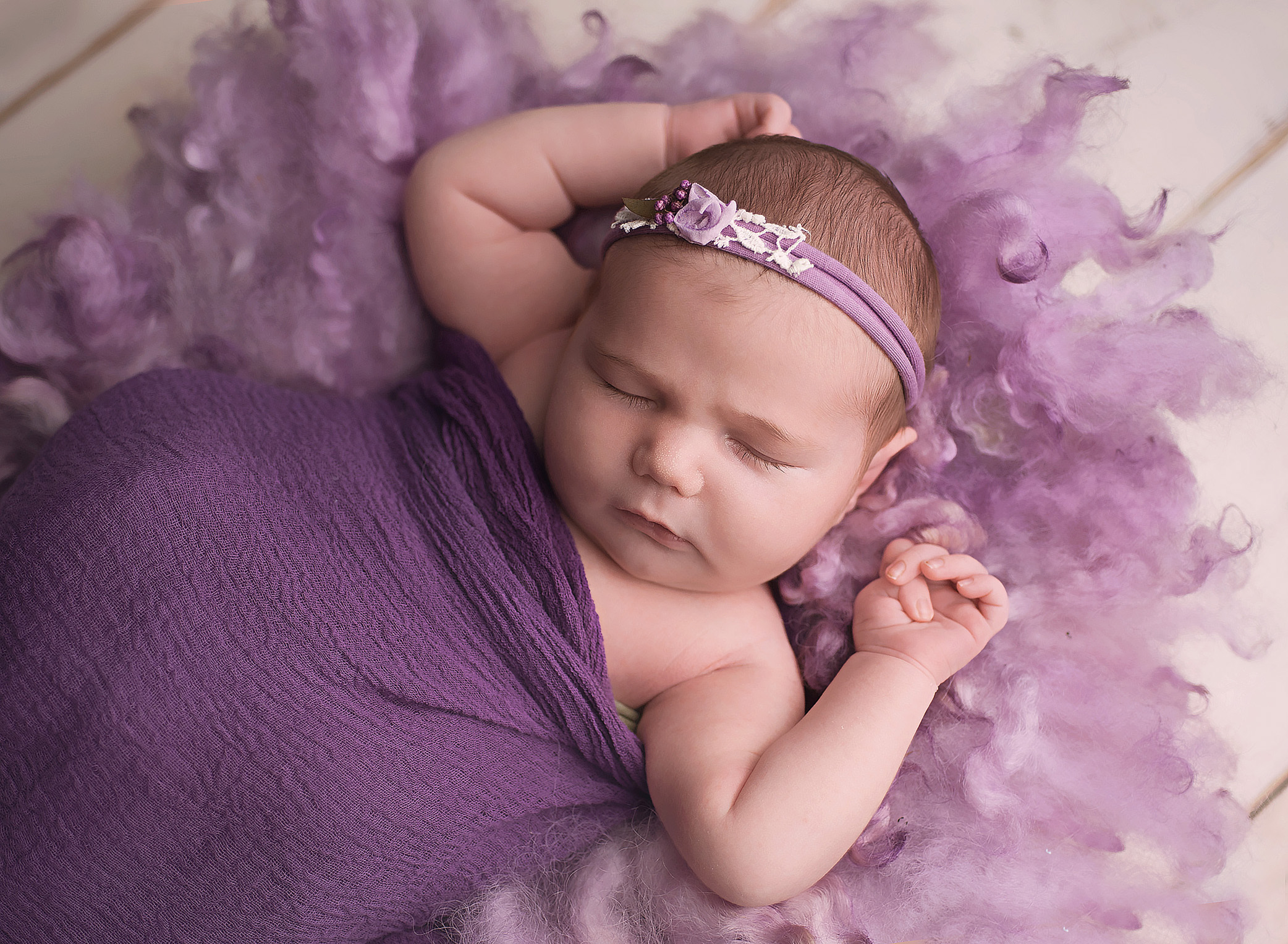 newborn baby girl in purple