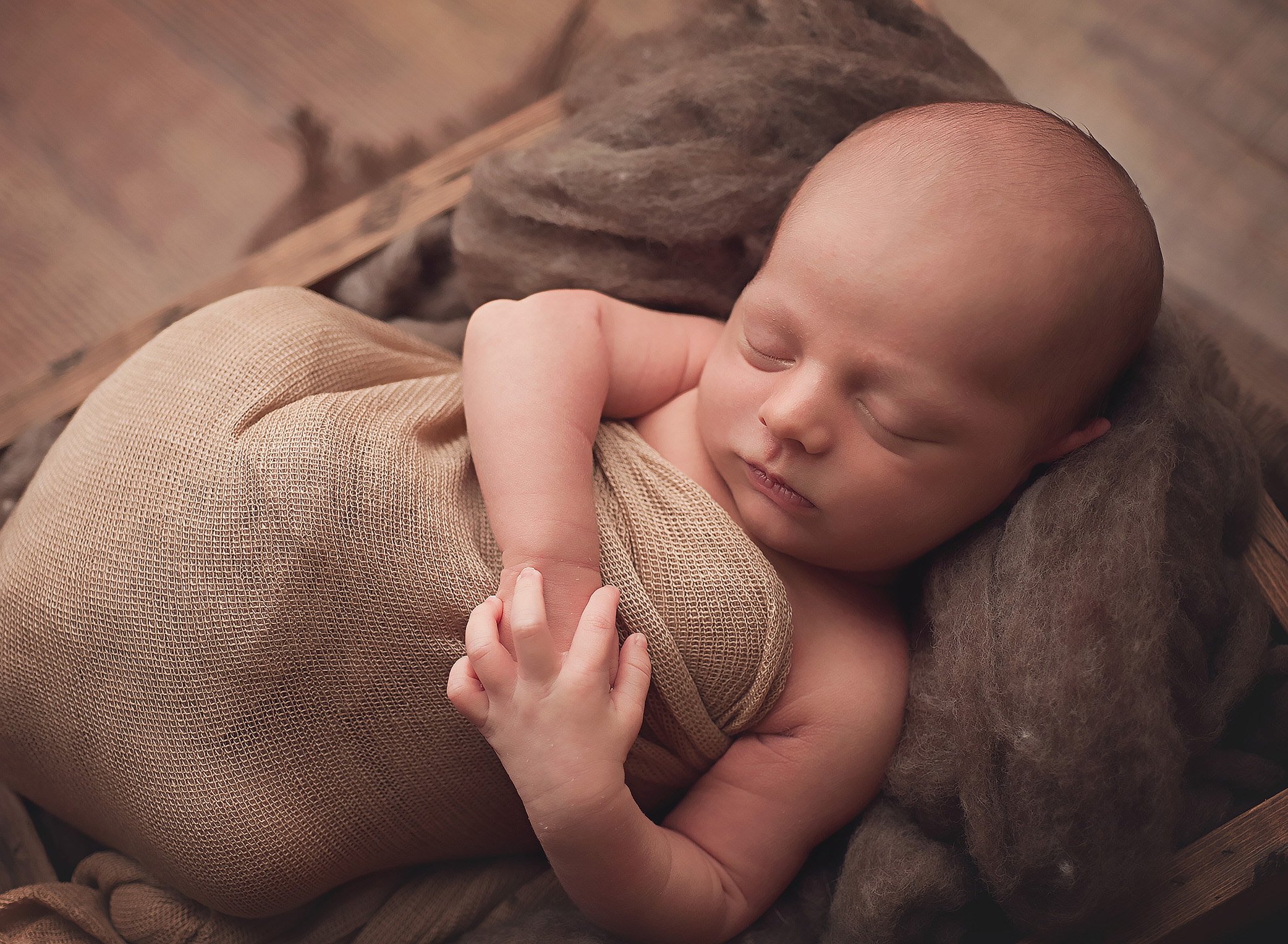 baby wrapped in neutral