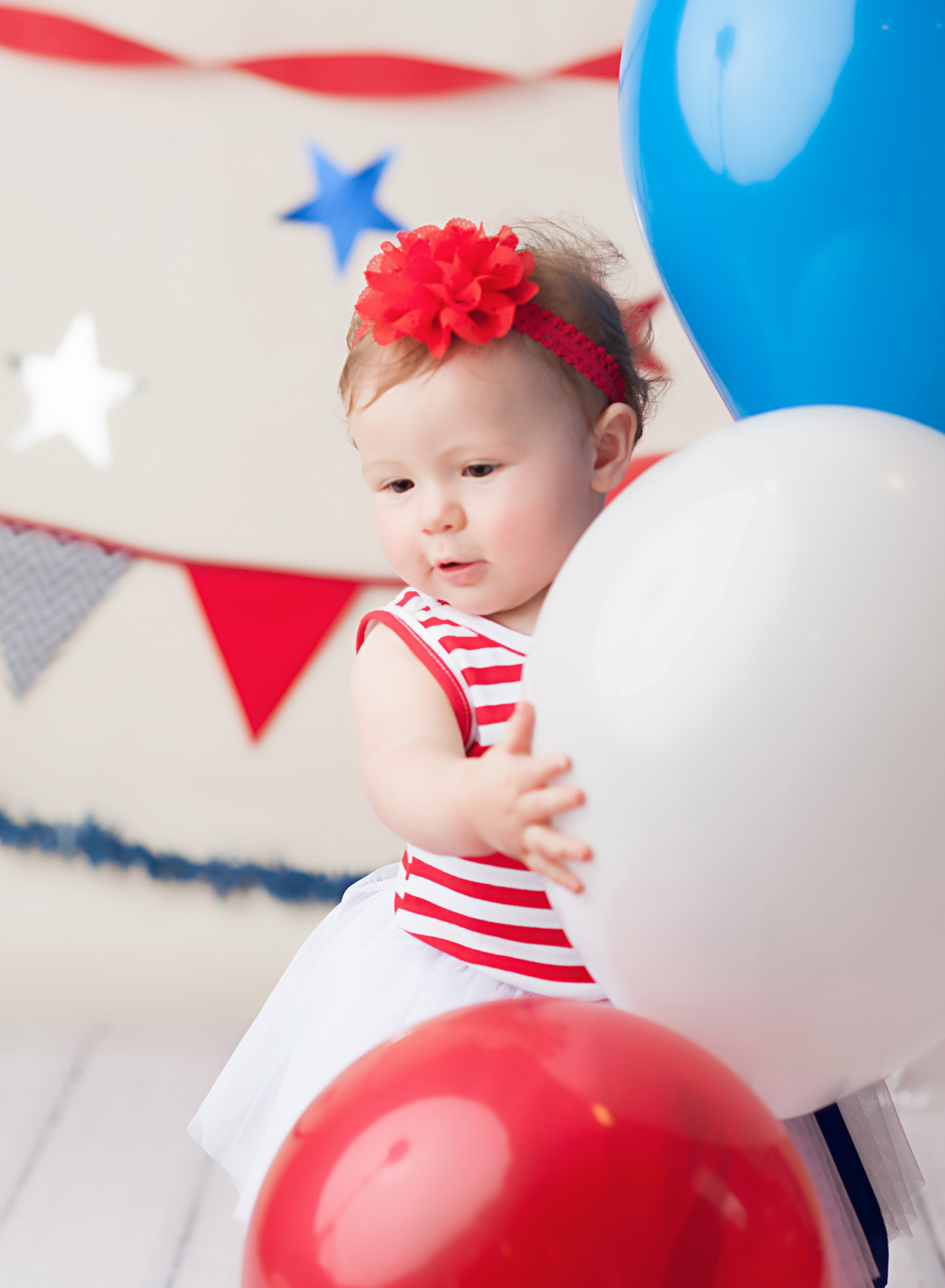 baby with white balloon
