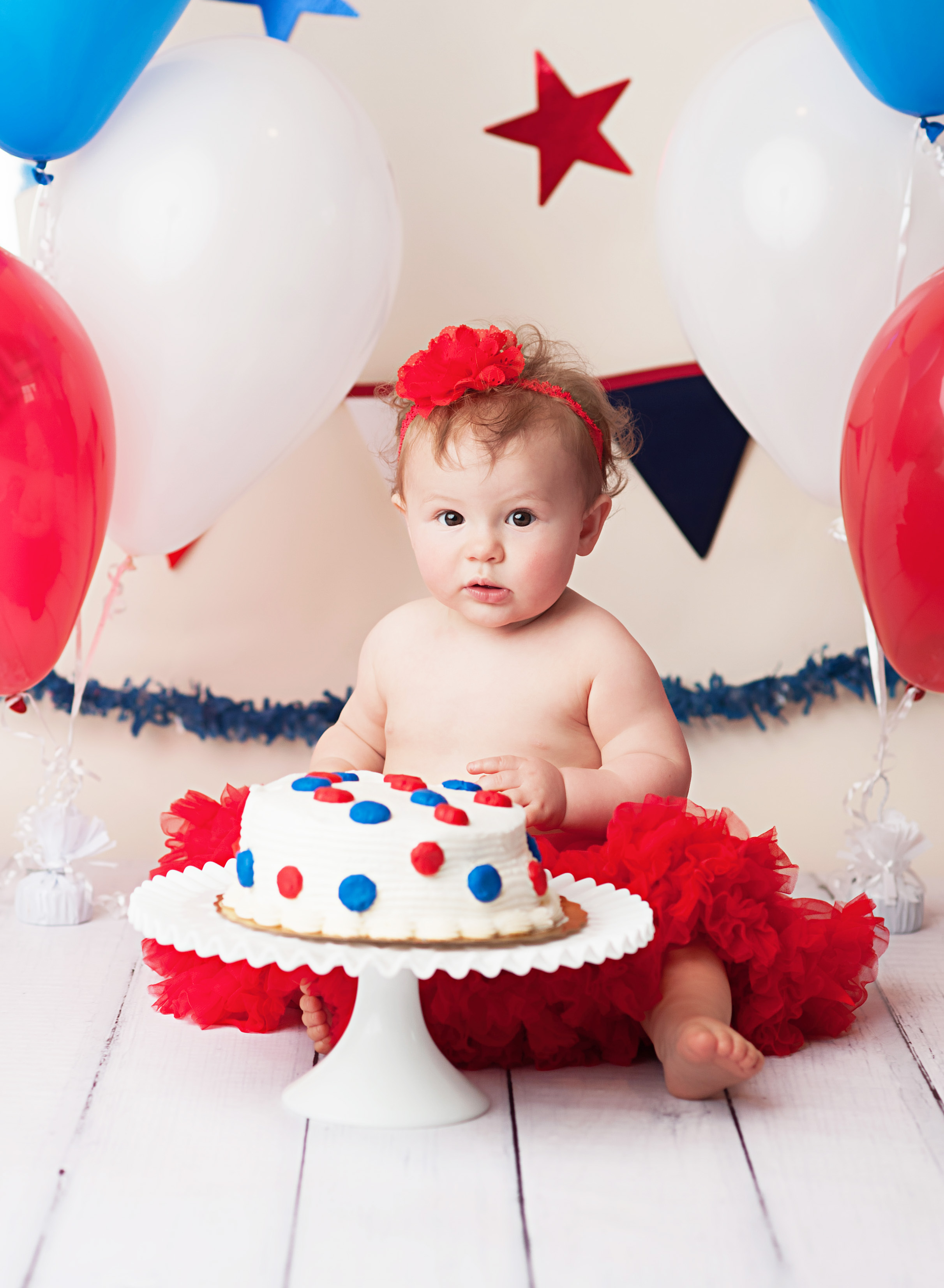 baby with patriotic cake smash