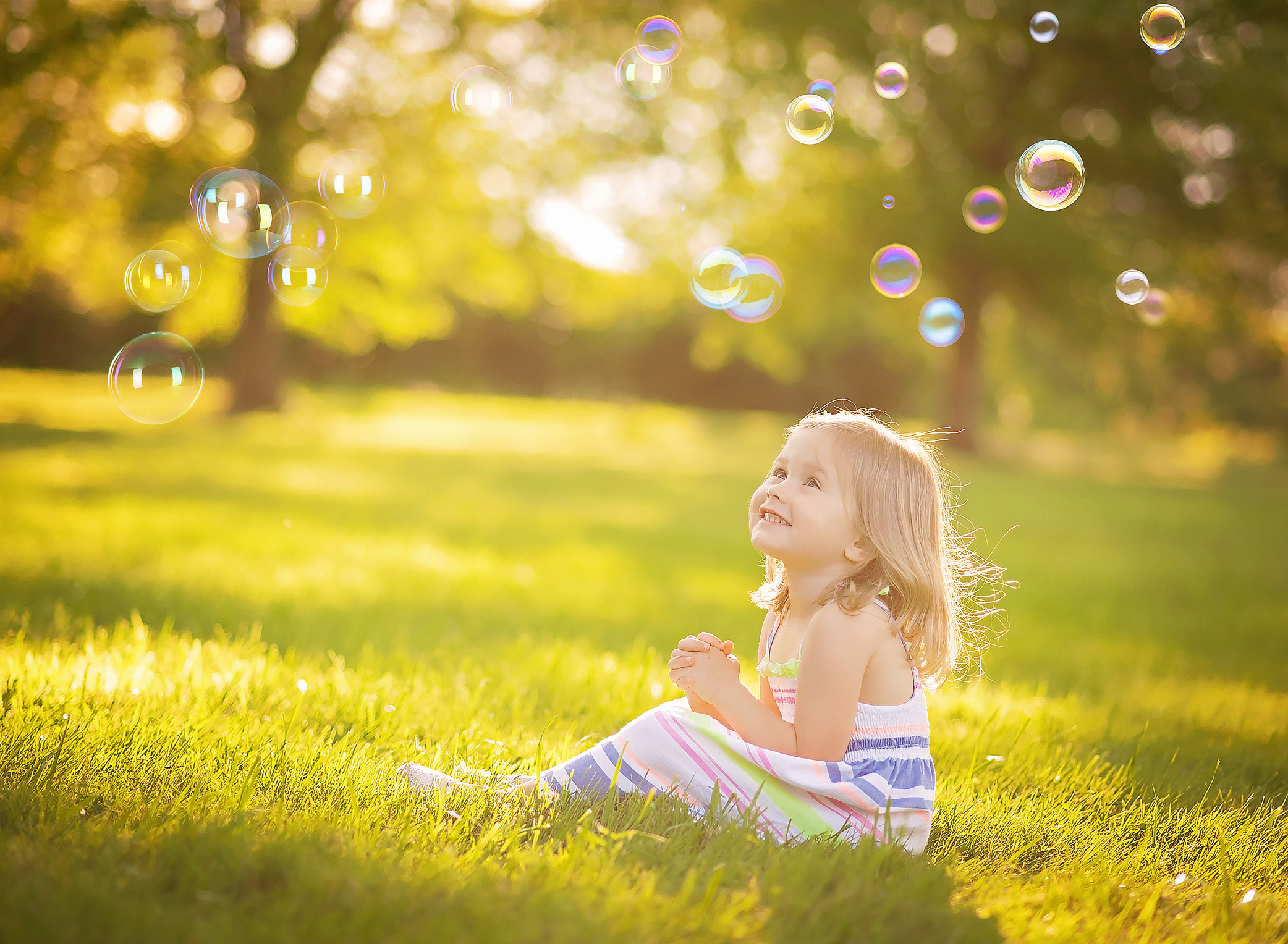 little girl watching bubbles