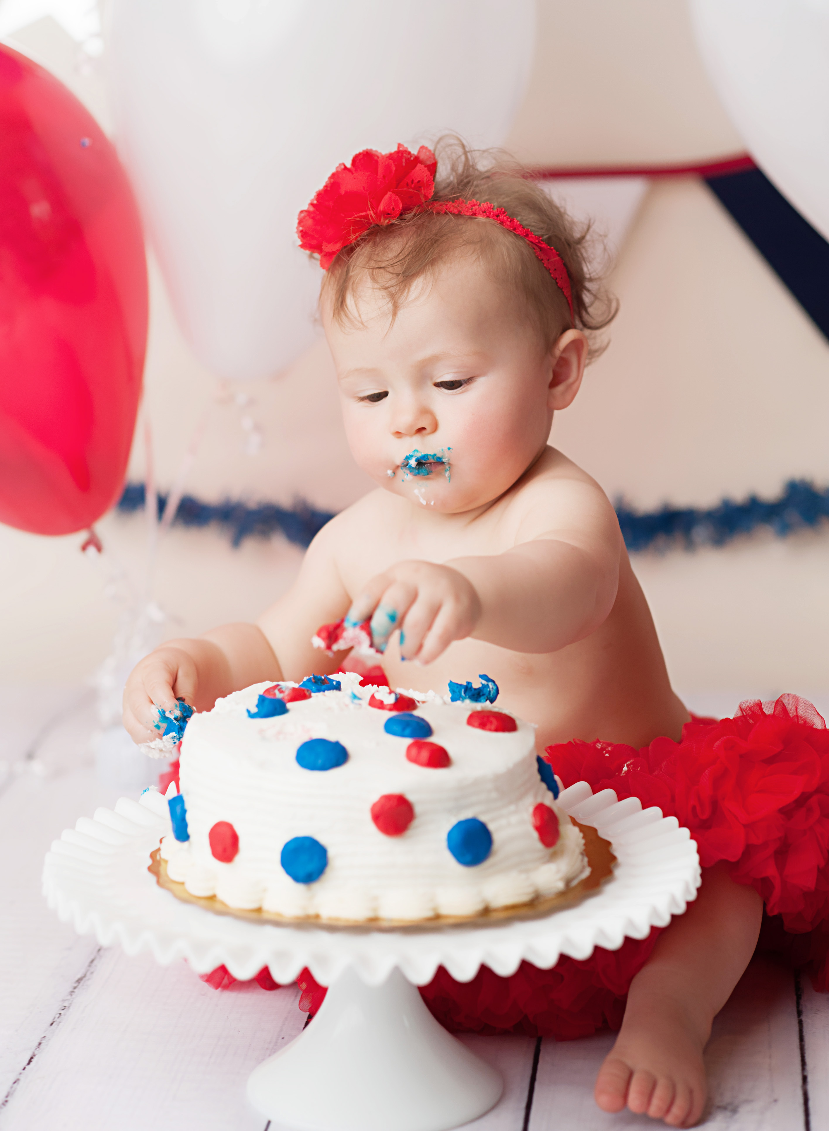 baby eating cake for cake smash session