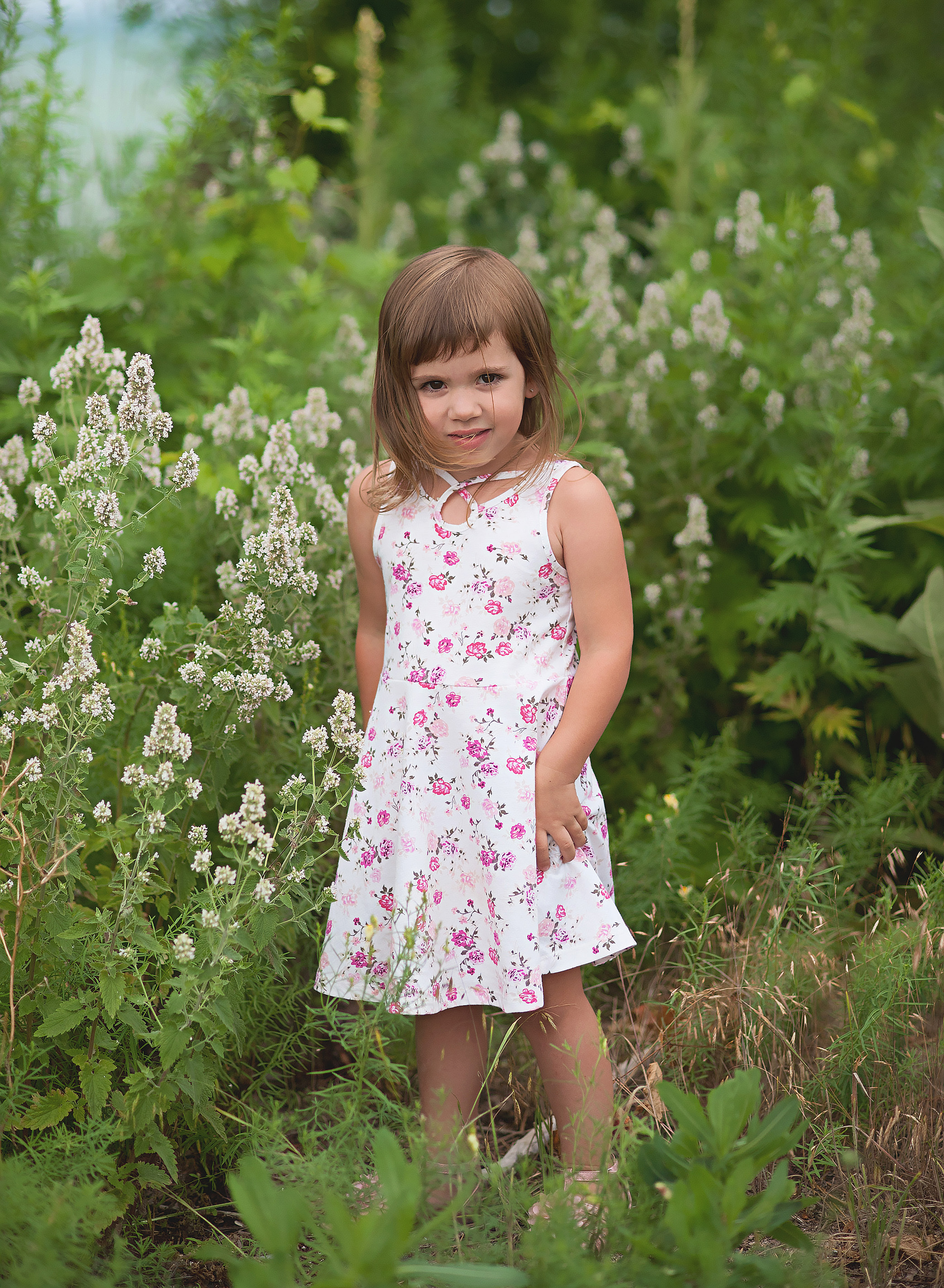 little girl standing in a field