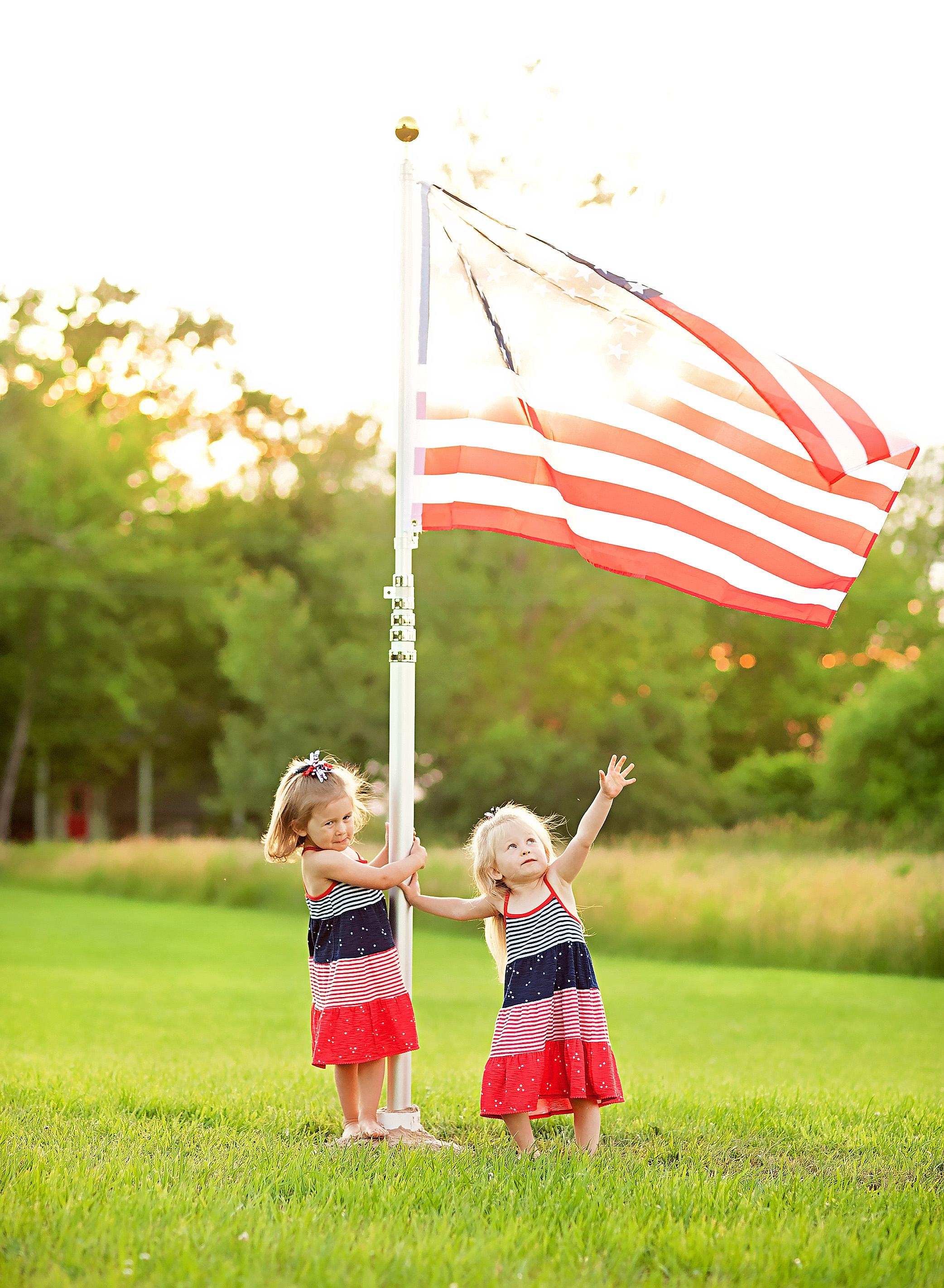 twin girls with american flag