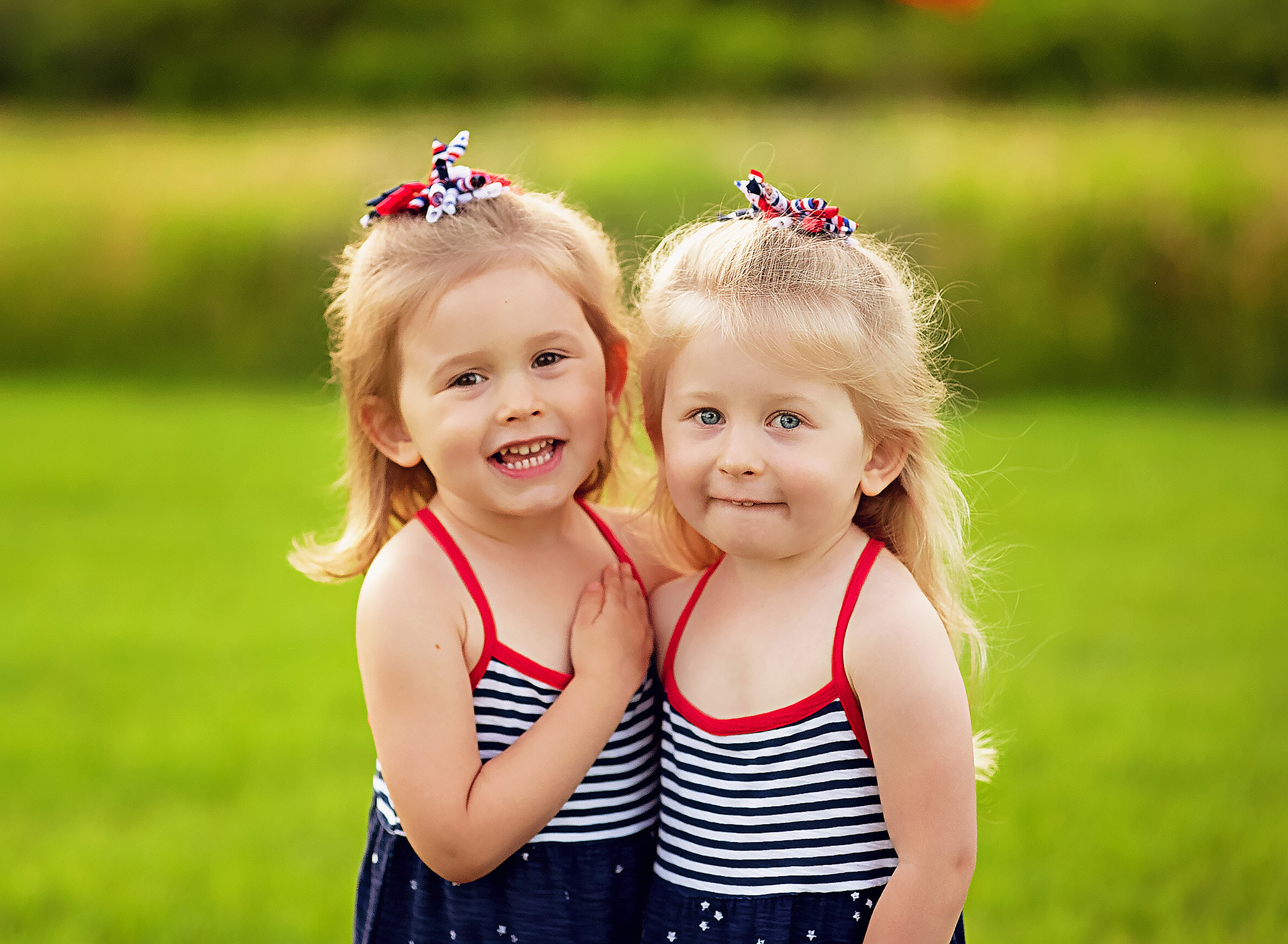 twin girls in field