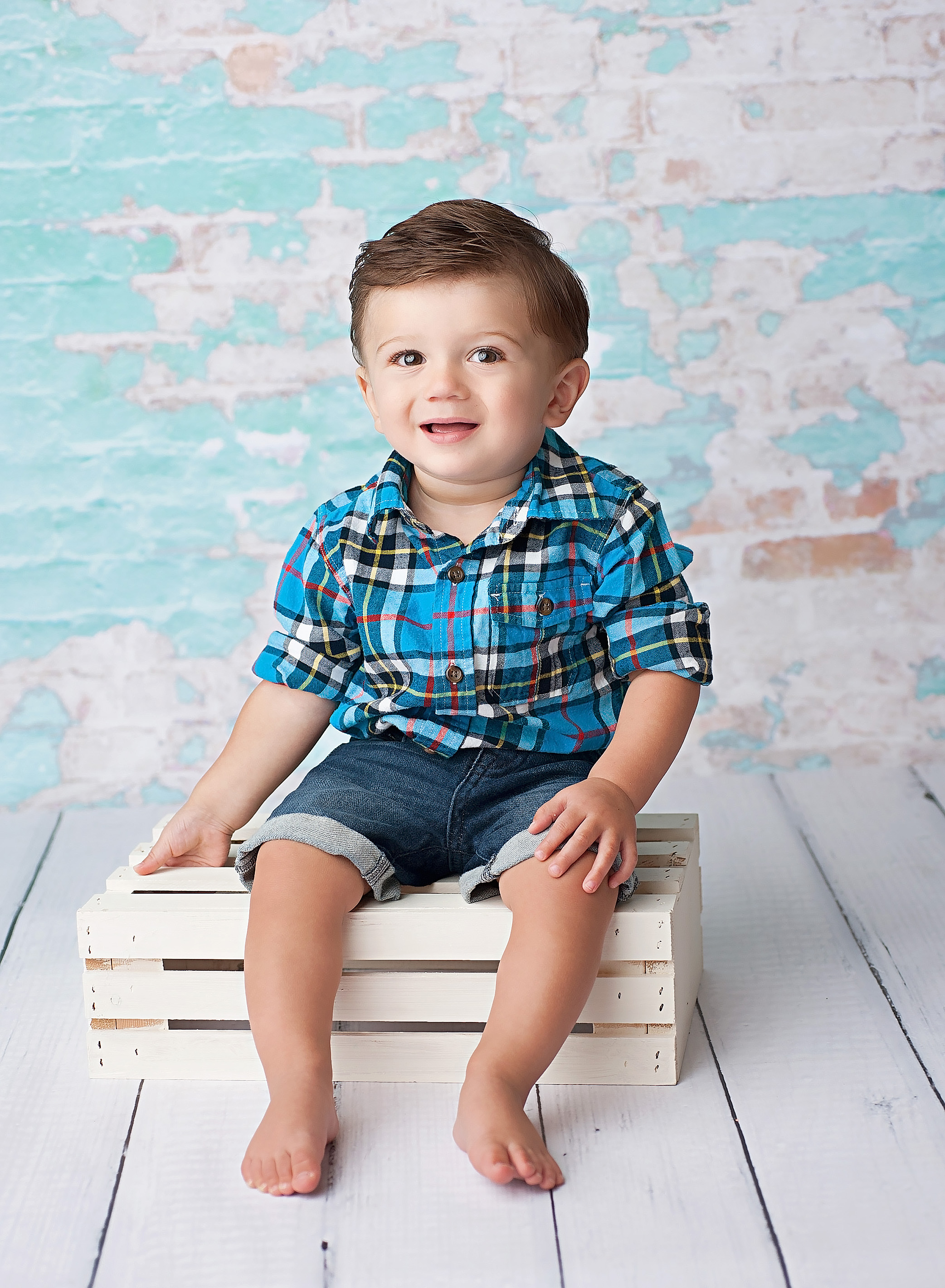 boy sitting on white crate