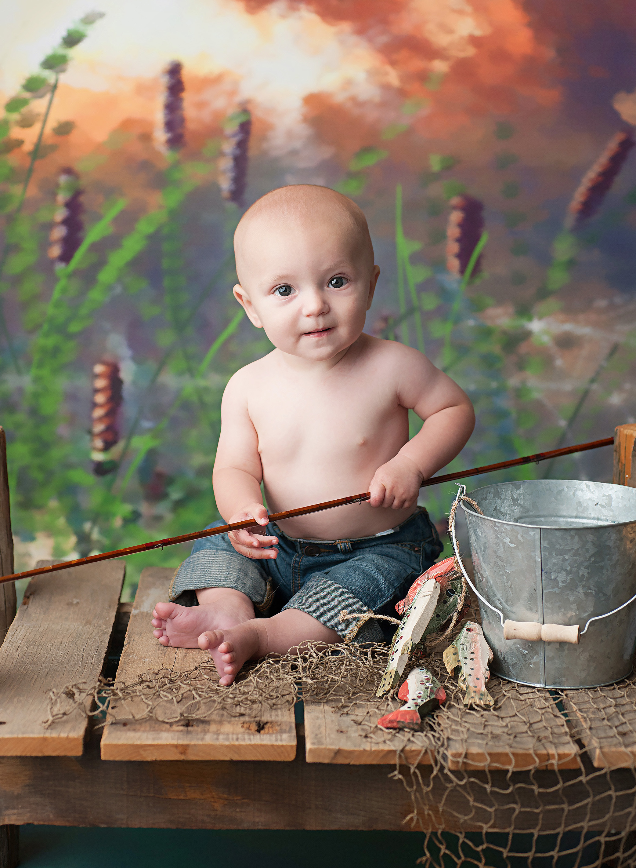 baby boy with a fishing pole
