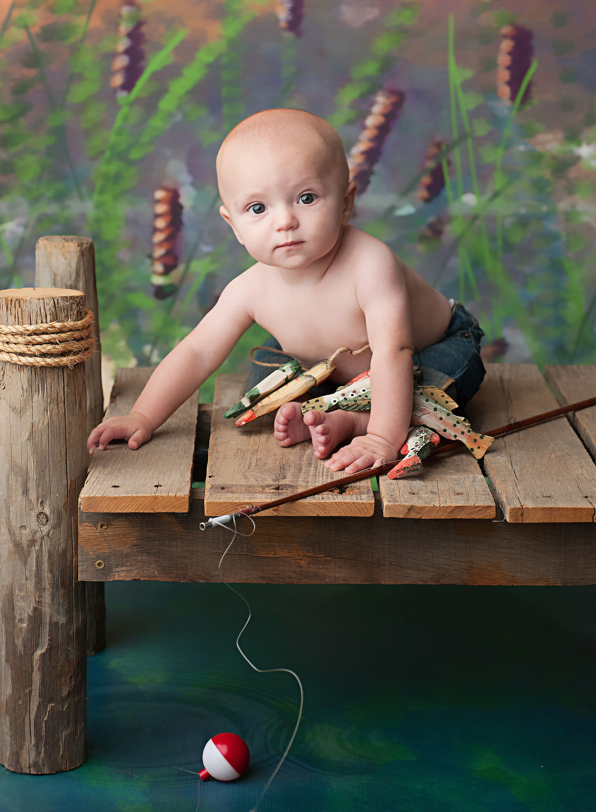 baby boy fishing portrait