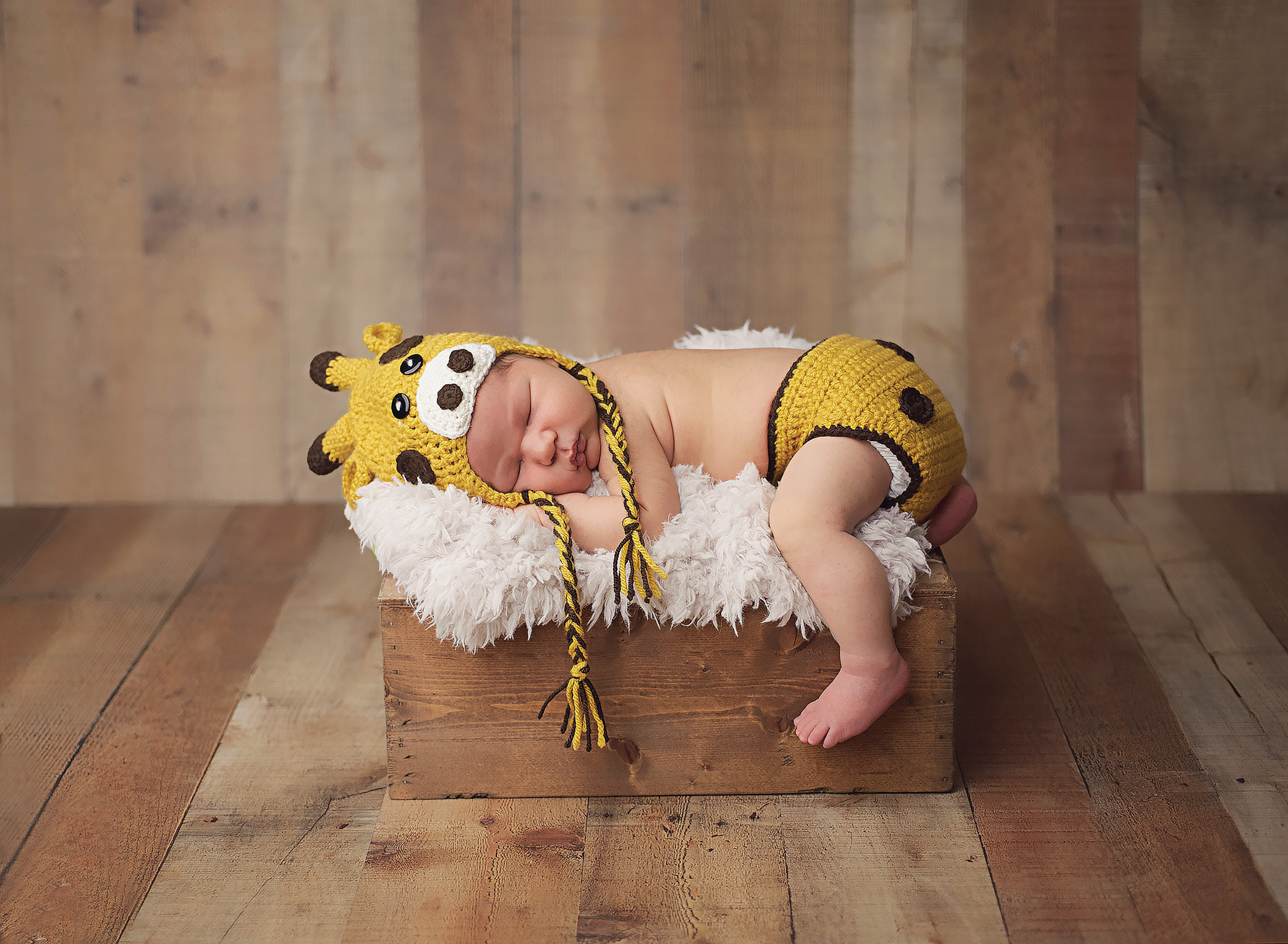 newborn boy in in giraffe outfit