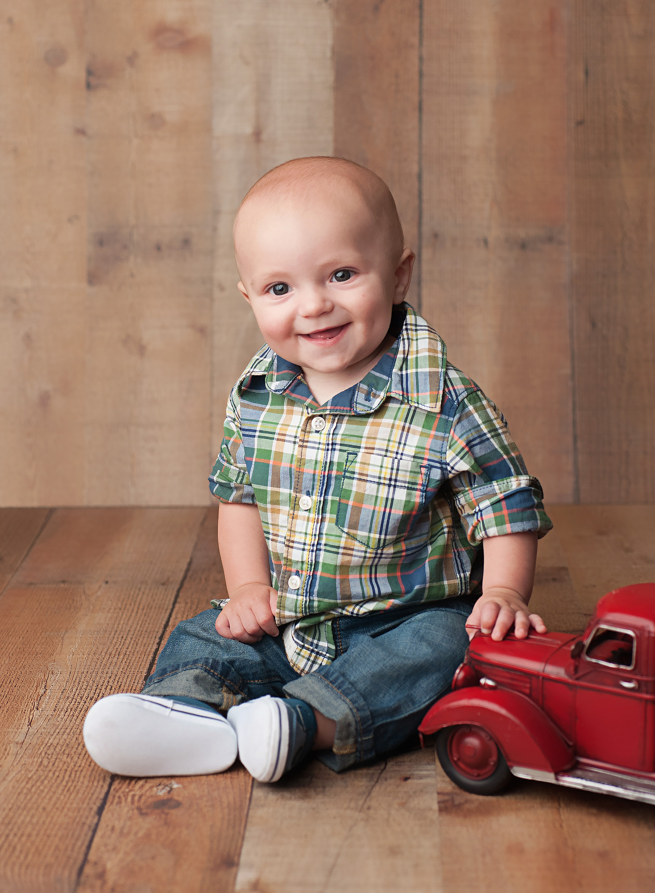 baby boy with red truck
