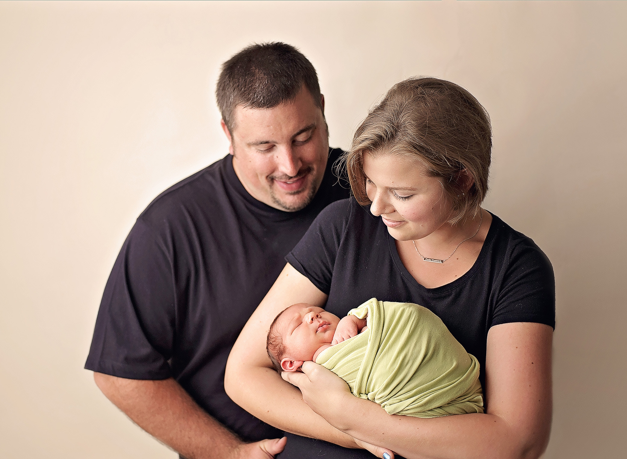 newborn boy with parents