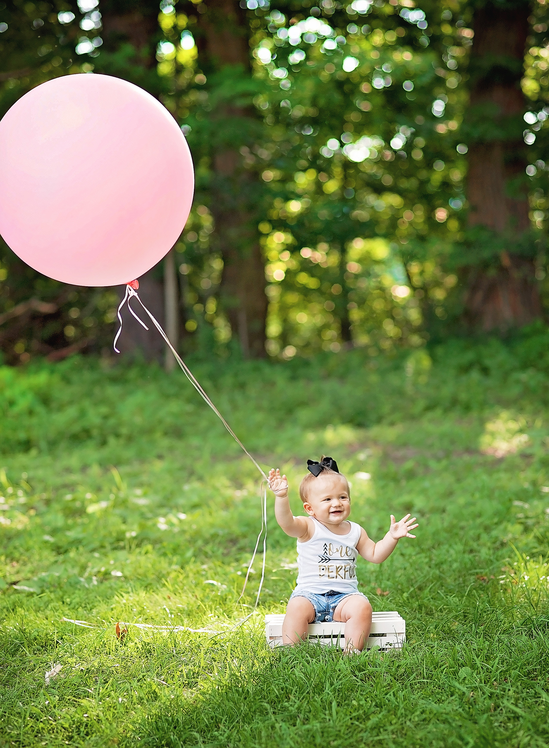 babygirl with large pink baloon