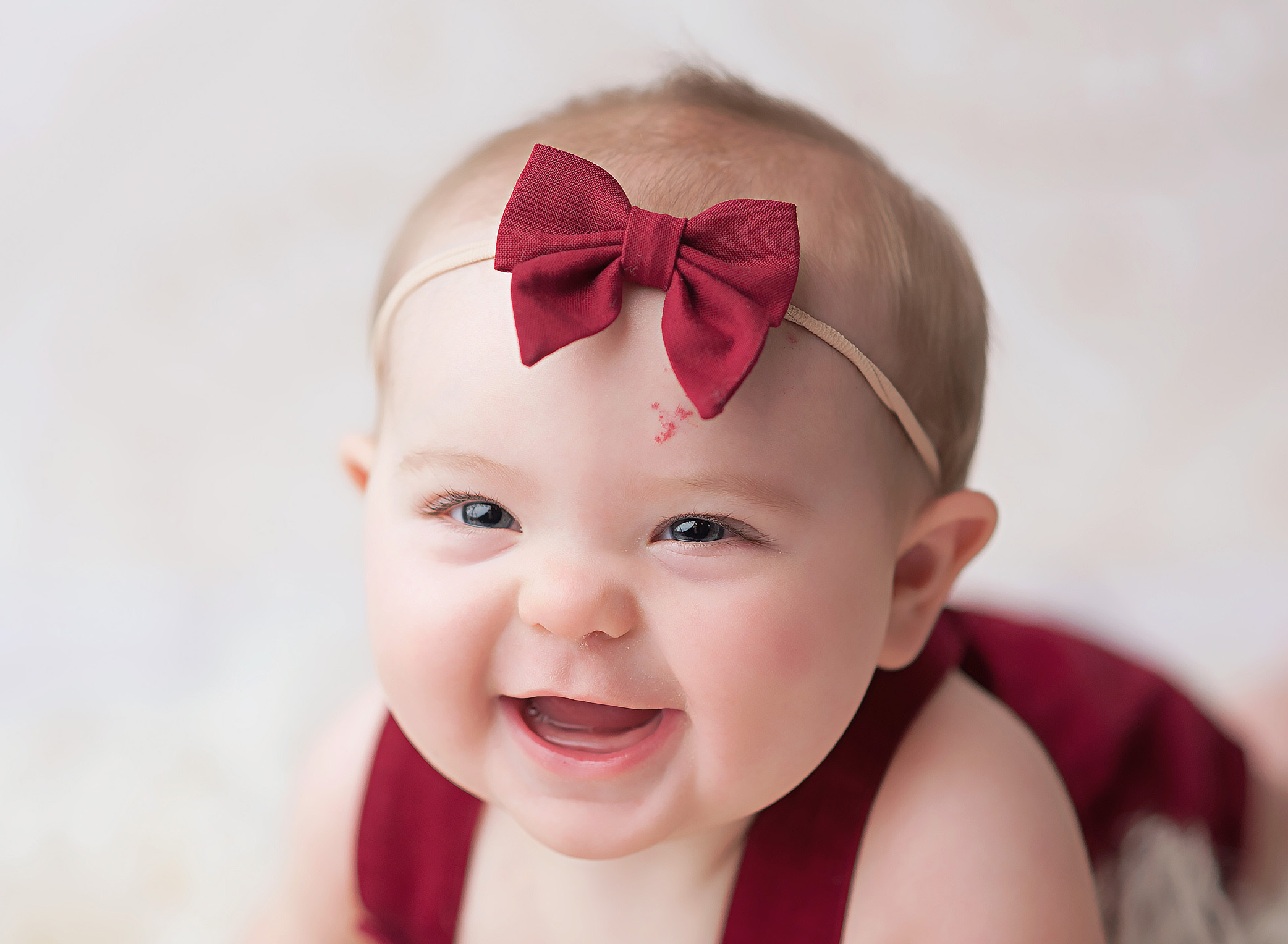 6 month old girl in red outfit