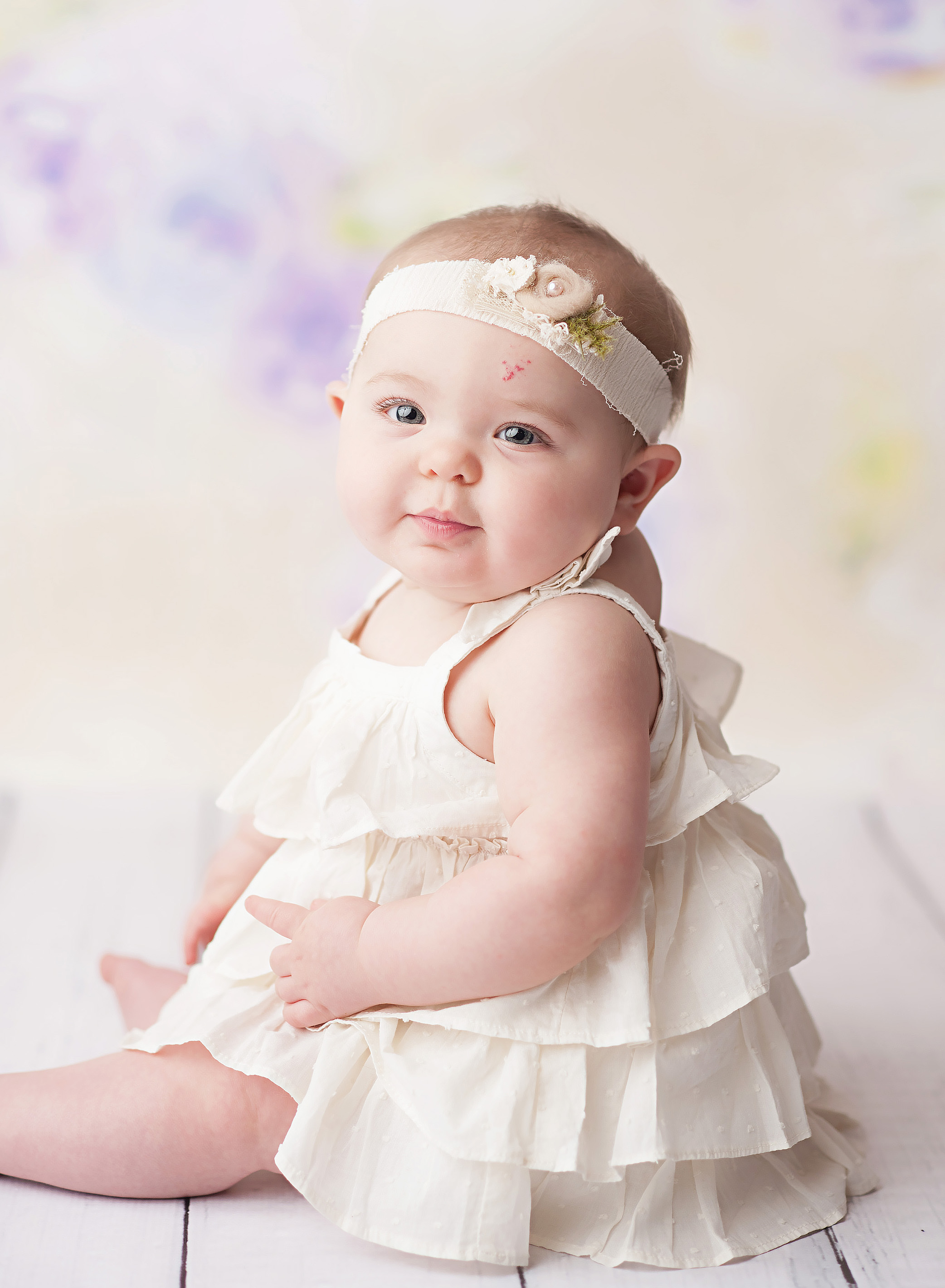 6 month old girl in white dress