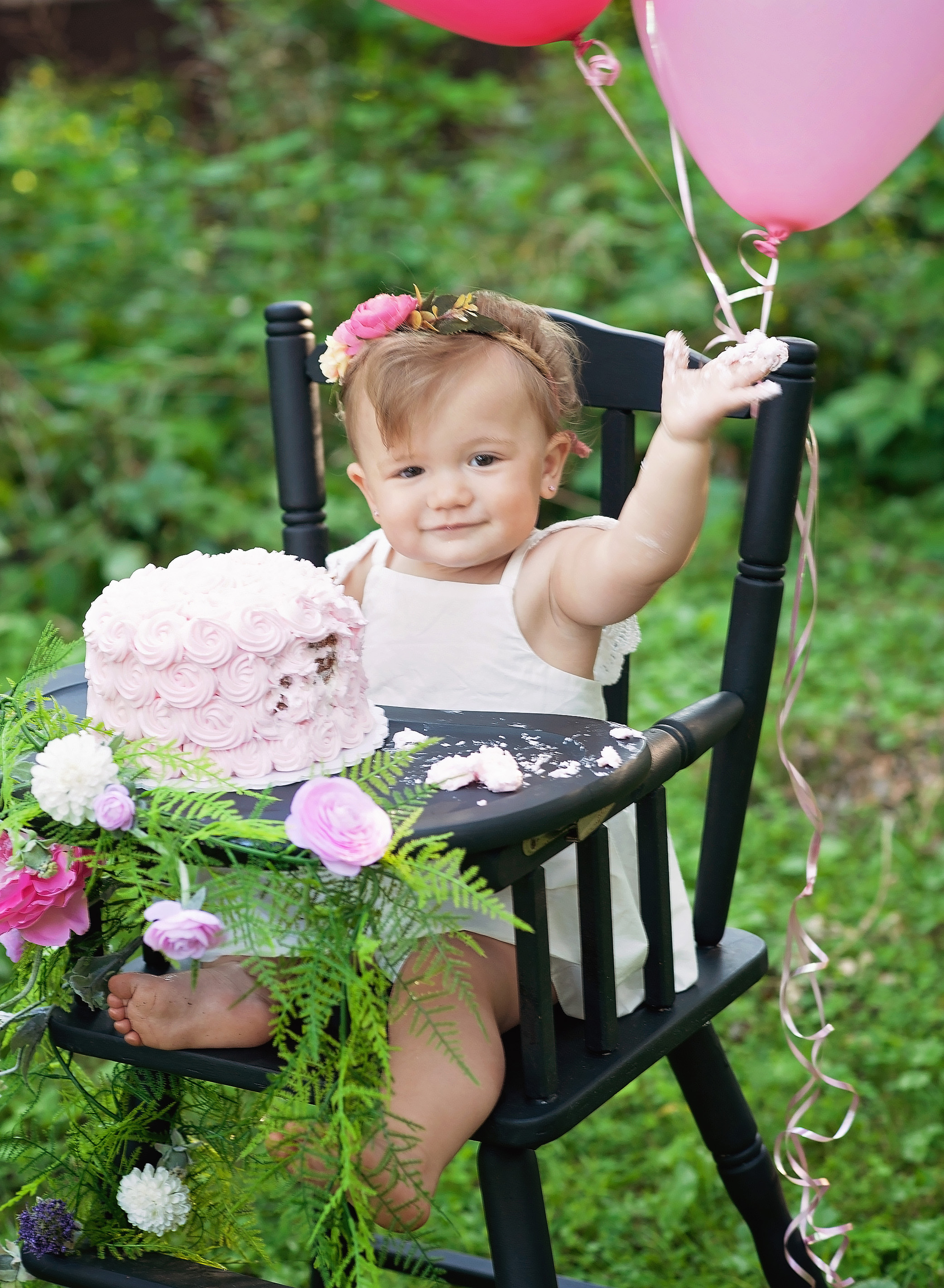 baby girl cake smash with pink balloons