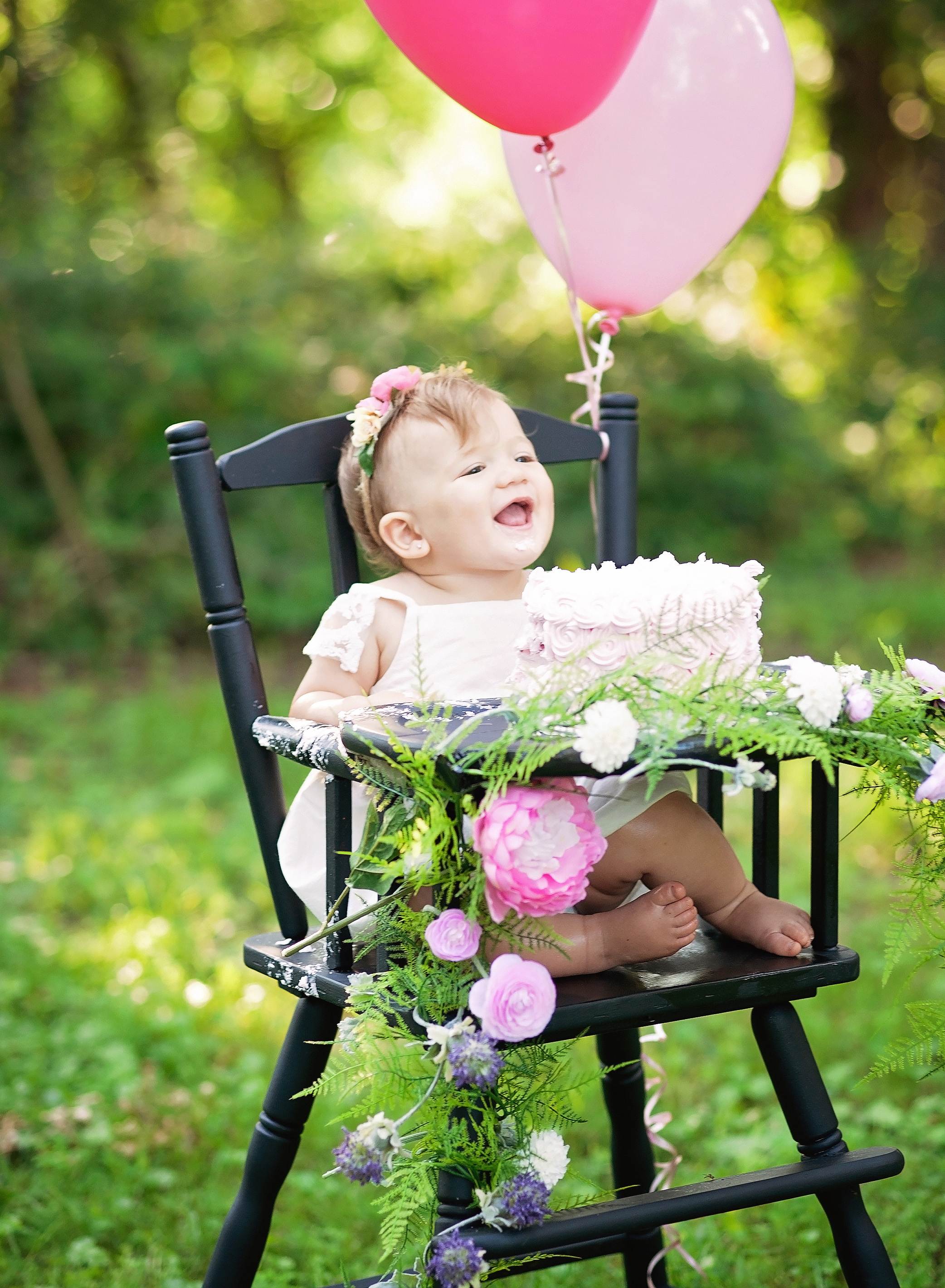 baby girl laughing in high chair