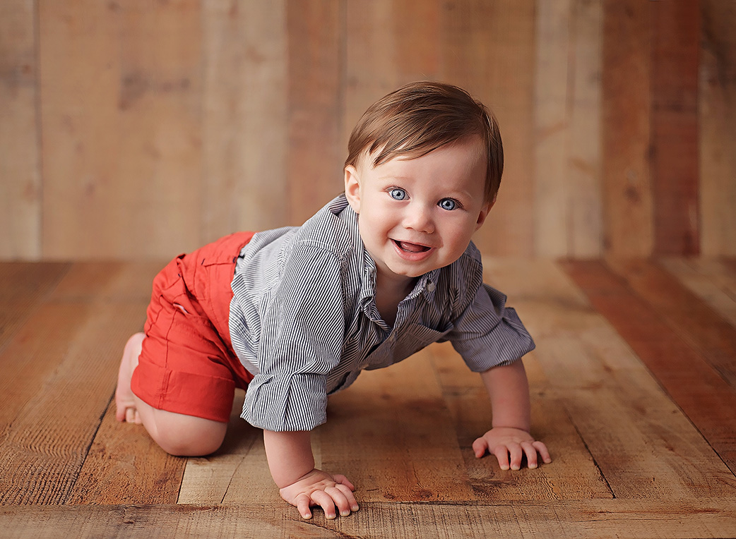 6 month old boy on wood backdrop