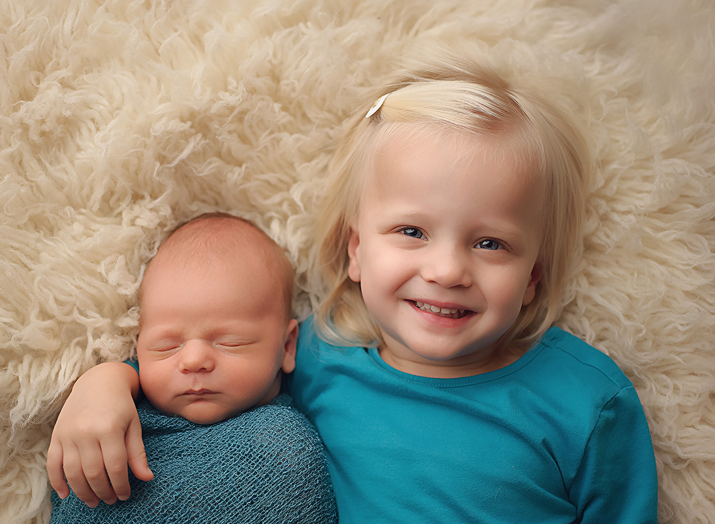 baby boy and his sister
