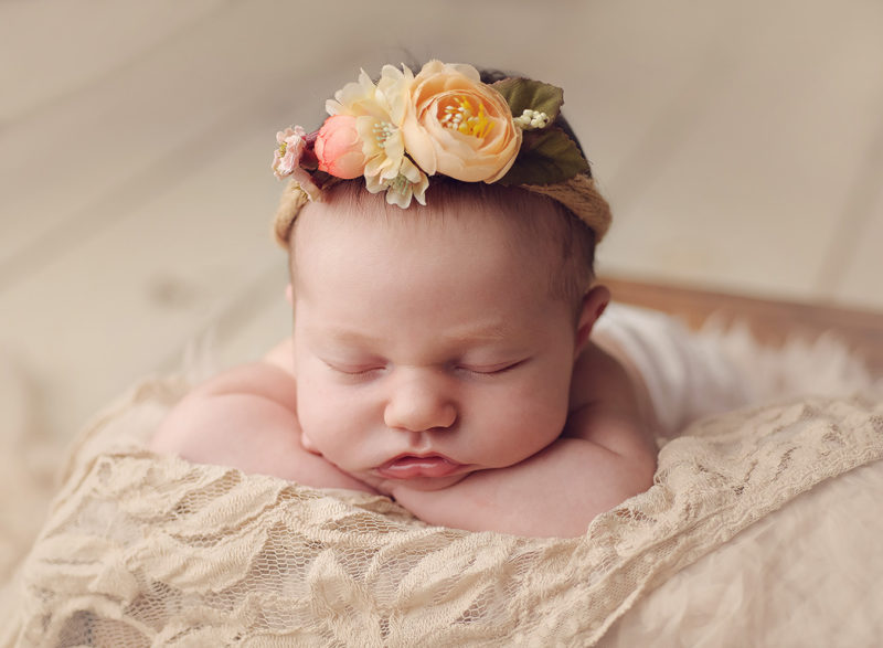 newborn baby with peach floral crown