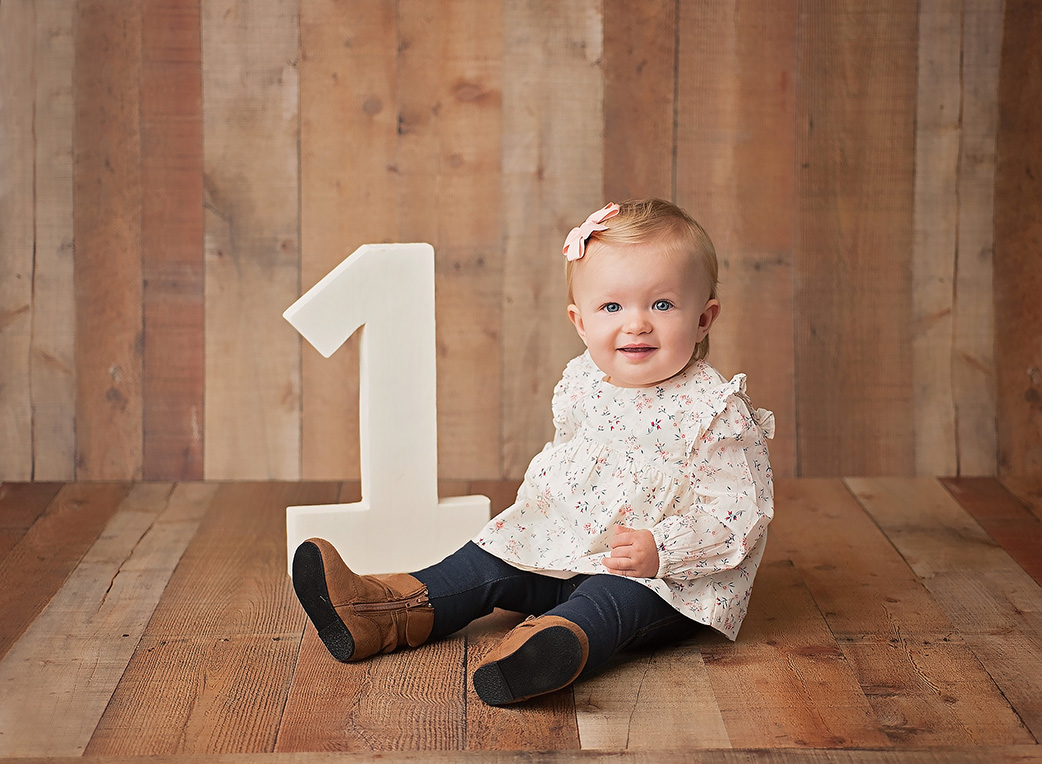 one year old baby girl with number 1