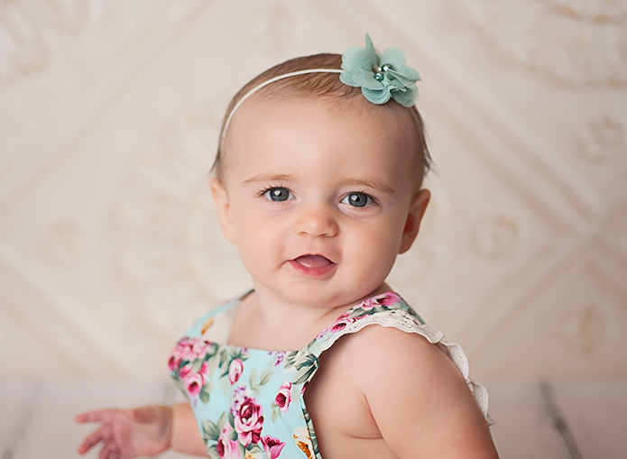 6 month old girl in blue floral romper