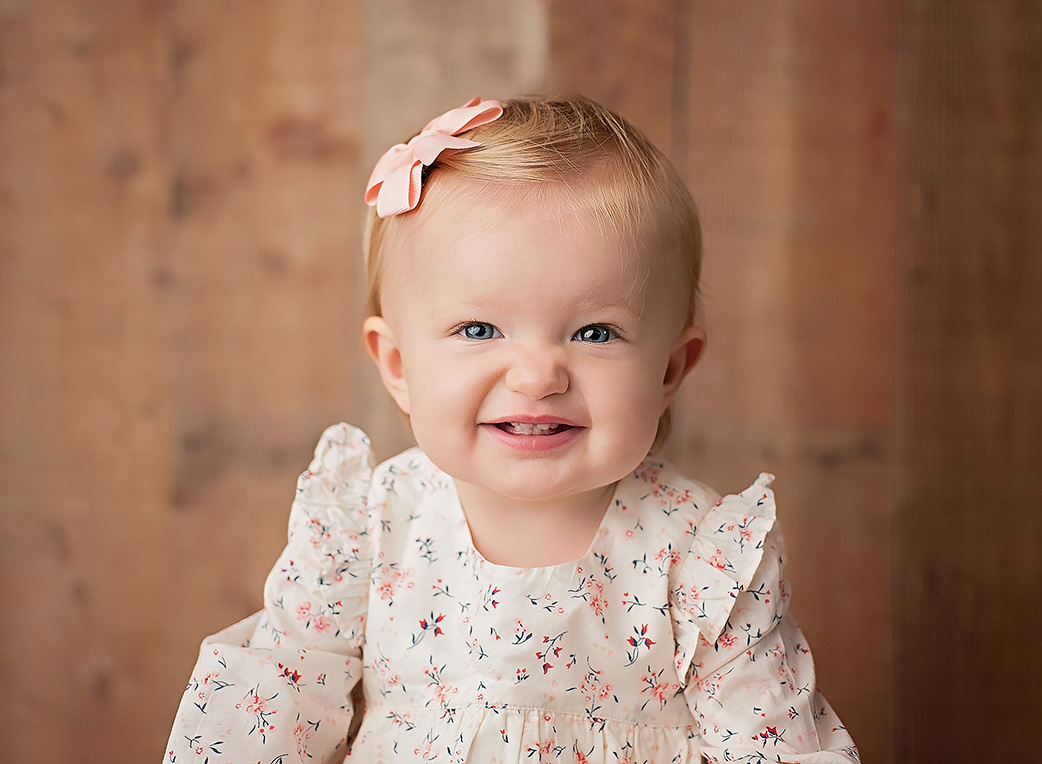 one year old girl smiling