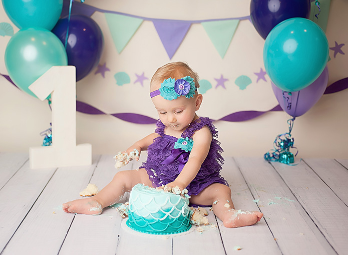 one year old eating mermaid cake