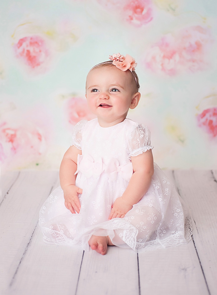 baby girl against floral backdrop
