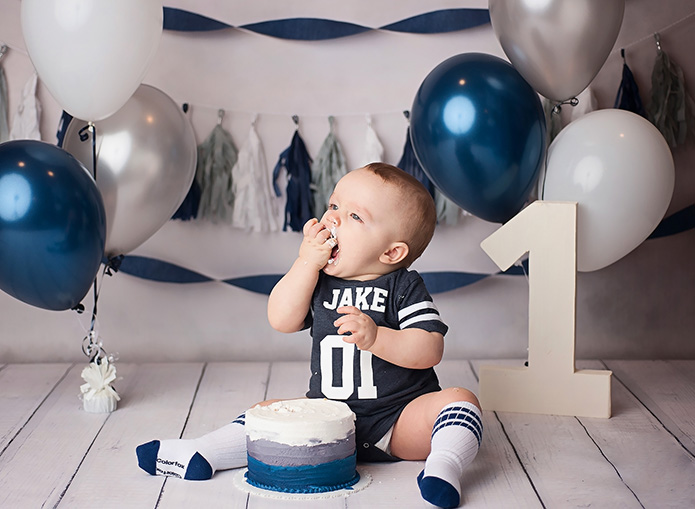 baby boy eating cake
