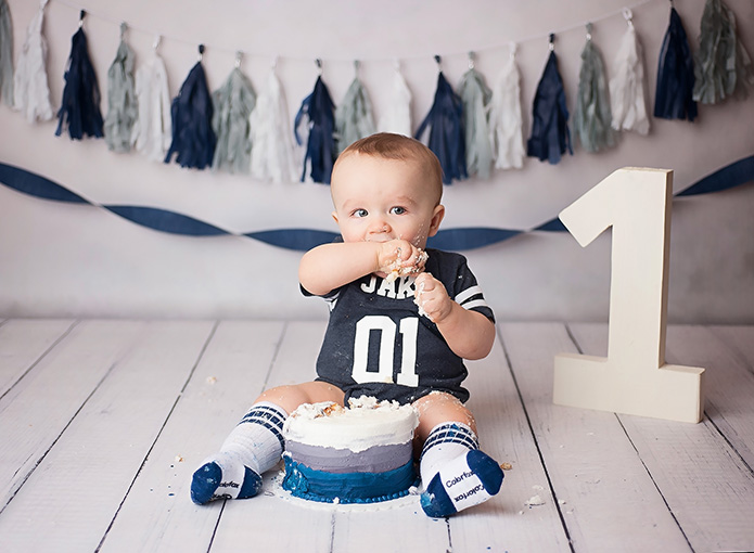 baby boy cake smash photos with navy and grey colors