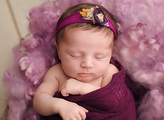baby girl wrapped im plum purple with purple fur