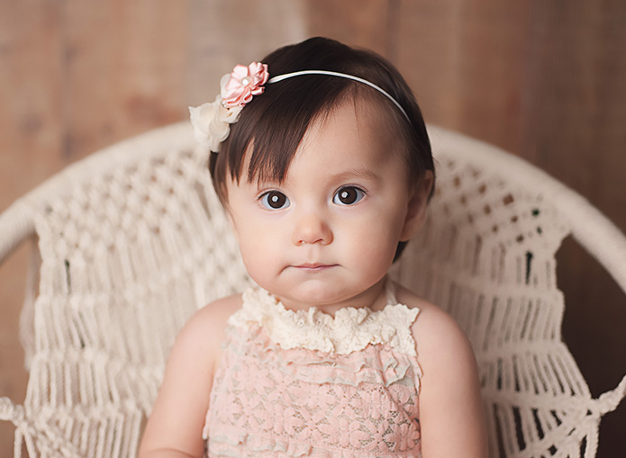 closeup of a baby girls face with a pink headband