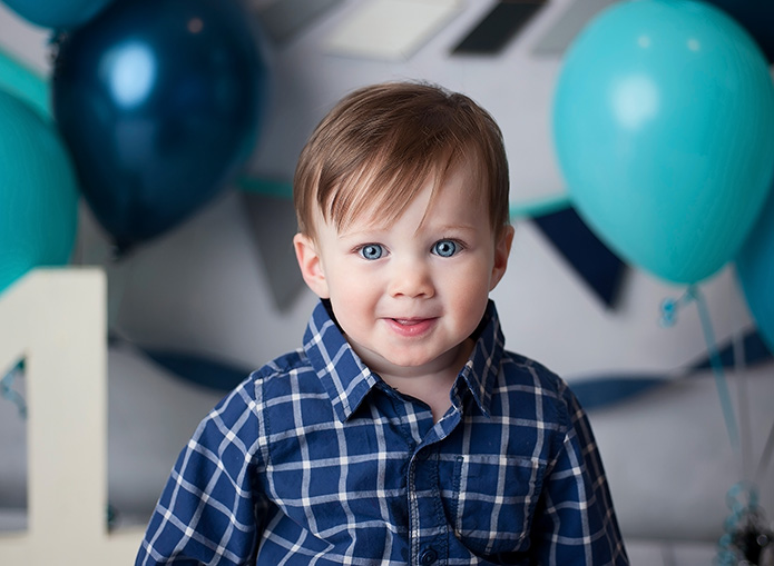 closeup of one year old boy smiling