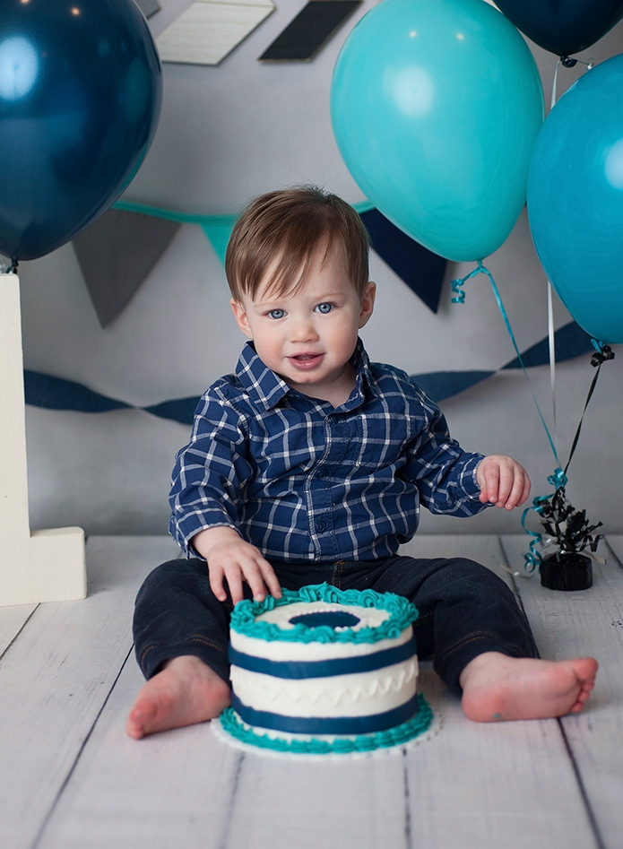 one year old boy eating cake