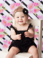 baby clapping in black romper