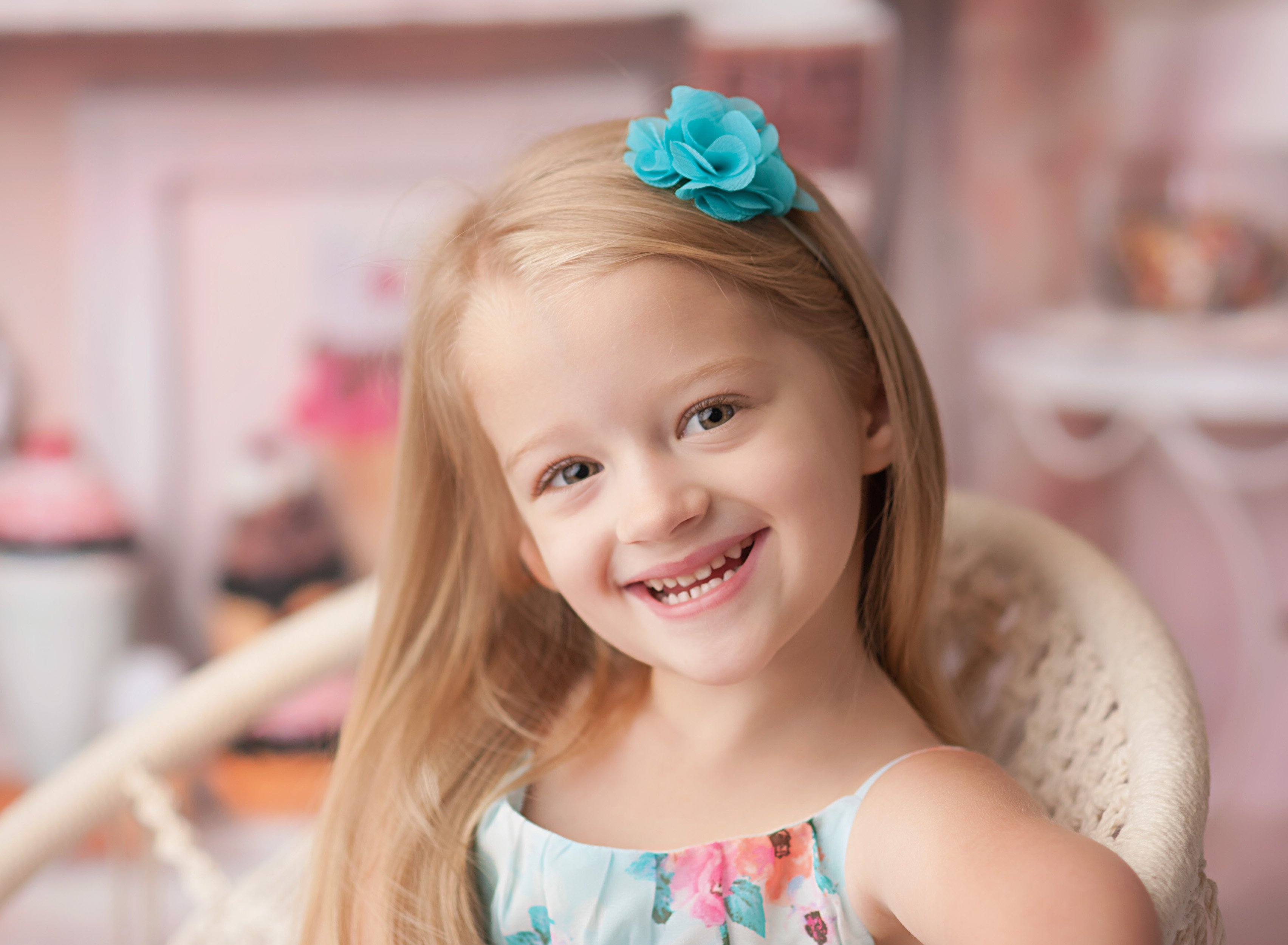 closeup of girl smiling against ice cream backdrop
