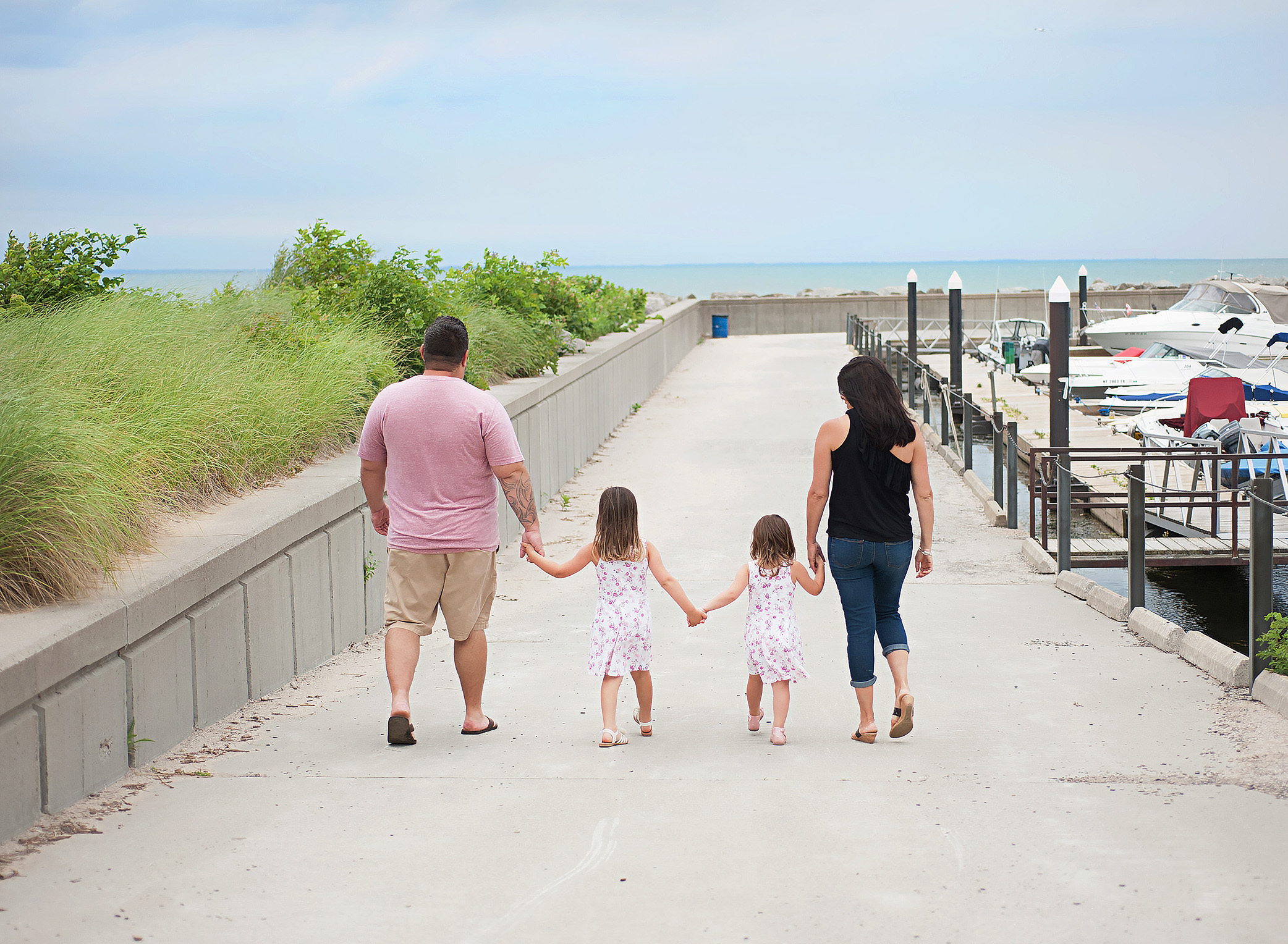 family walking on a pier at the beach