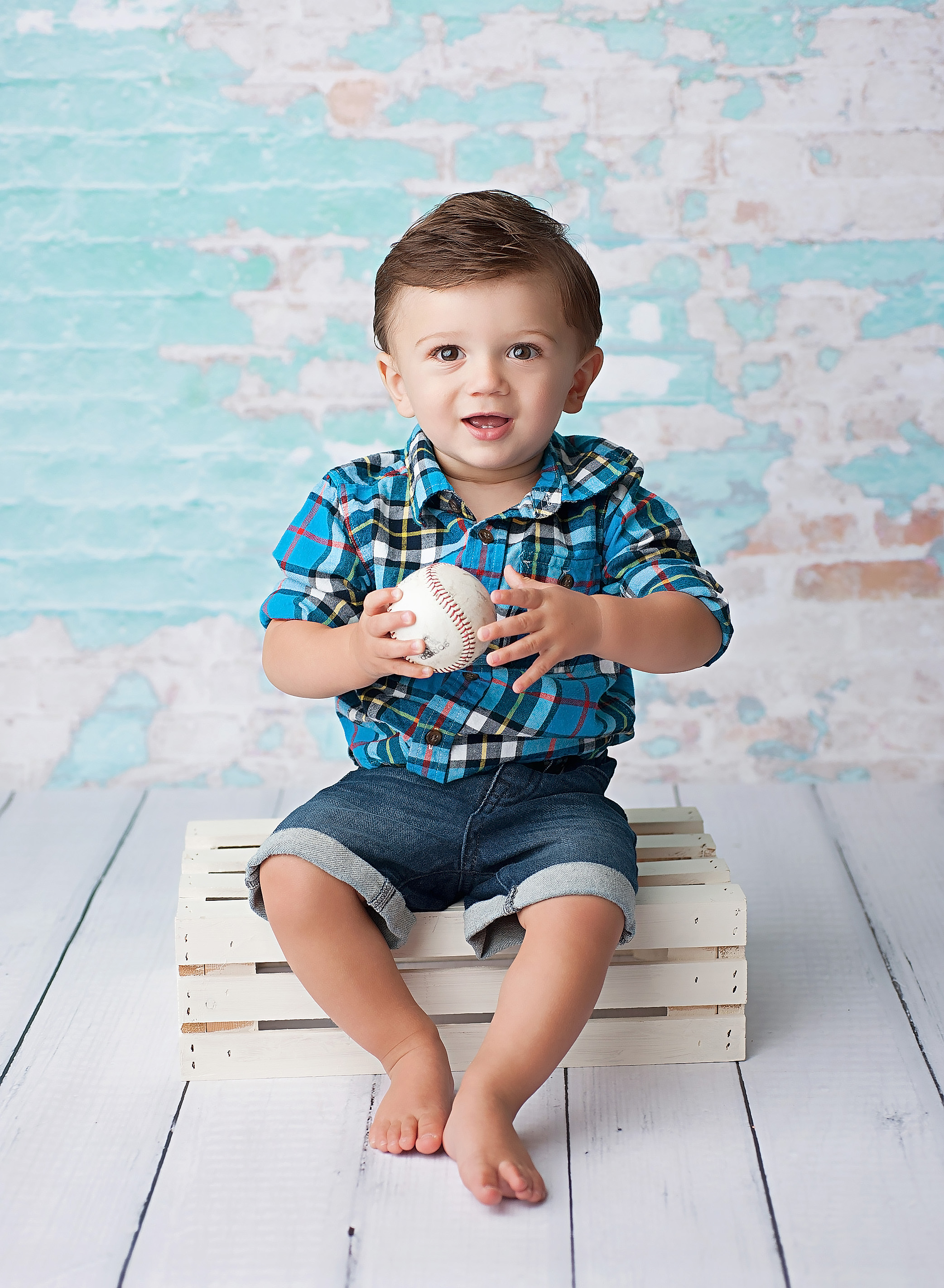 boy sitting on white rate