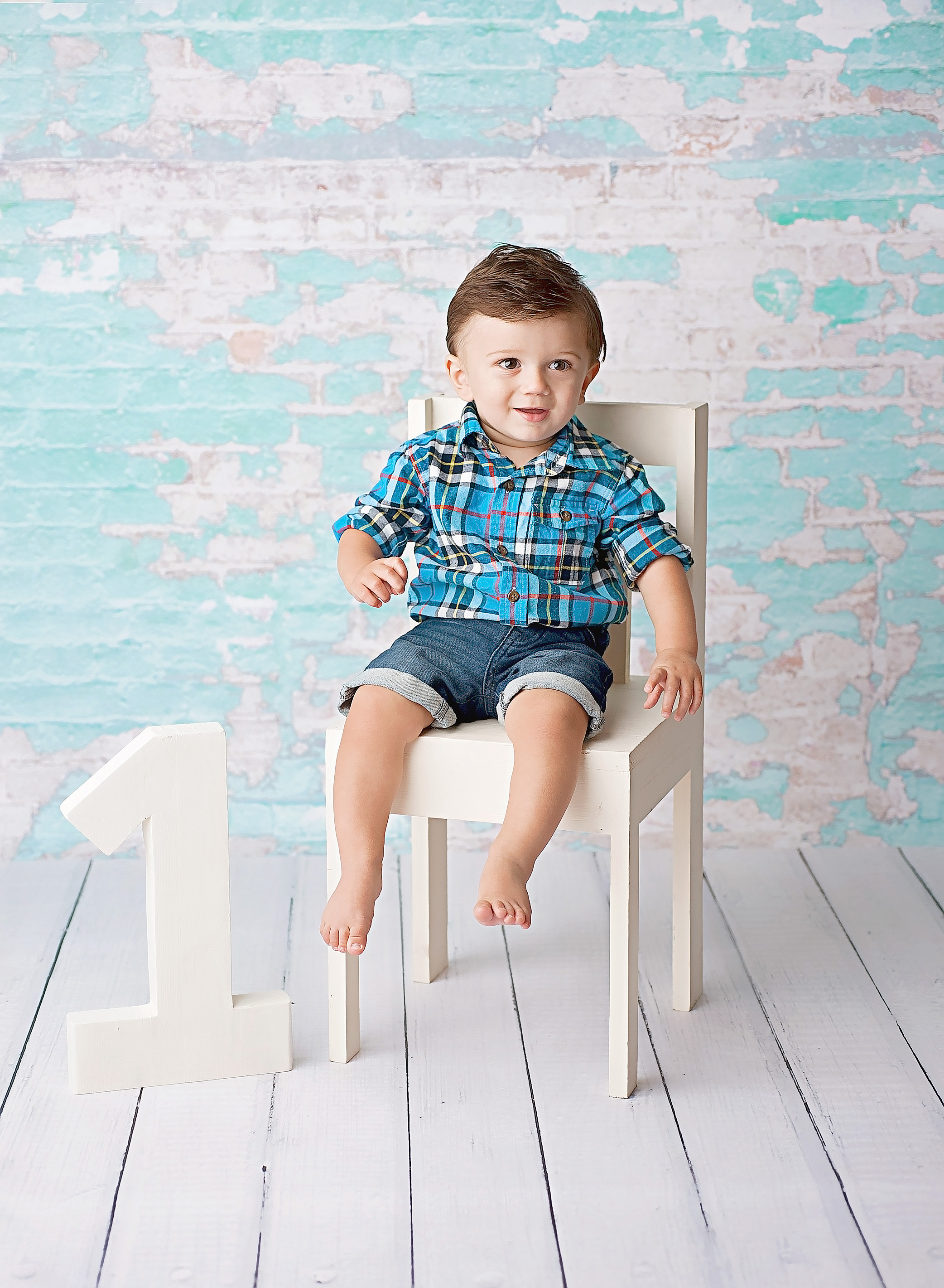 boy standing by white chair