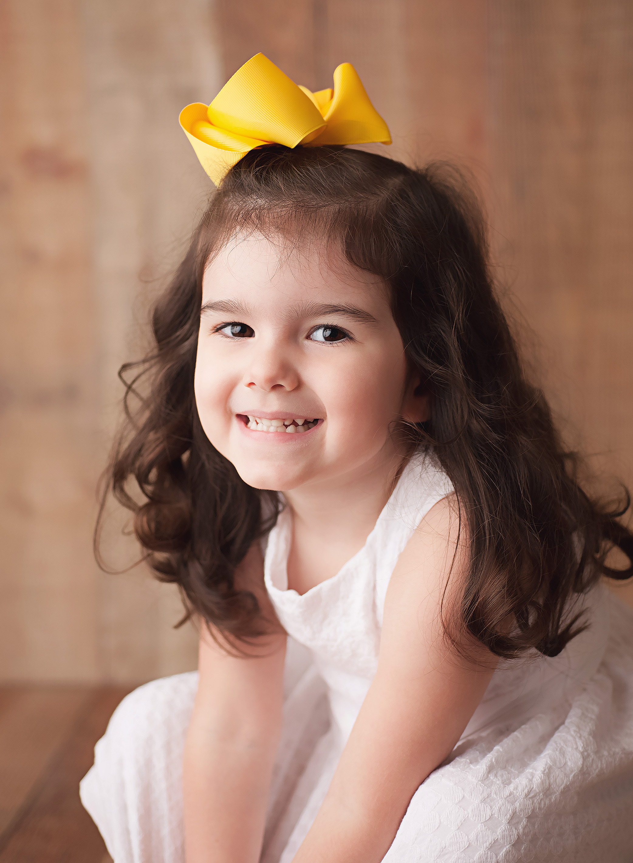 girl with big yellow bow
