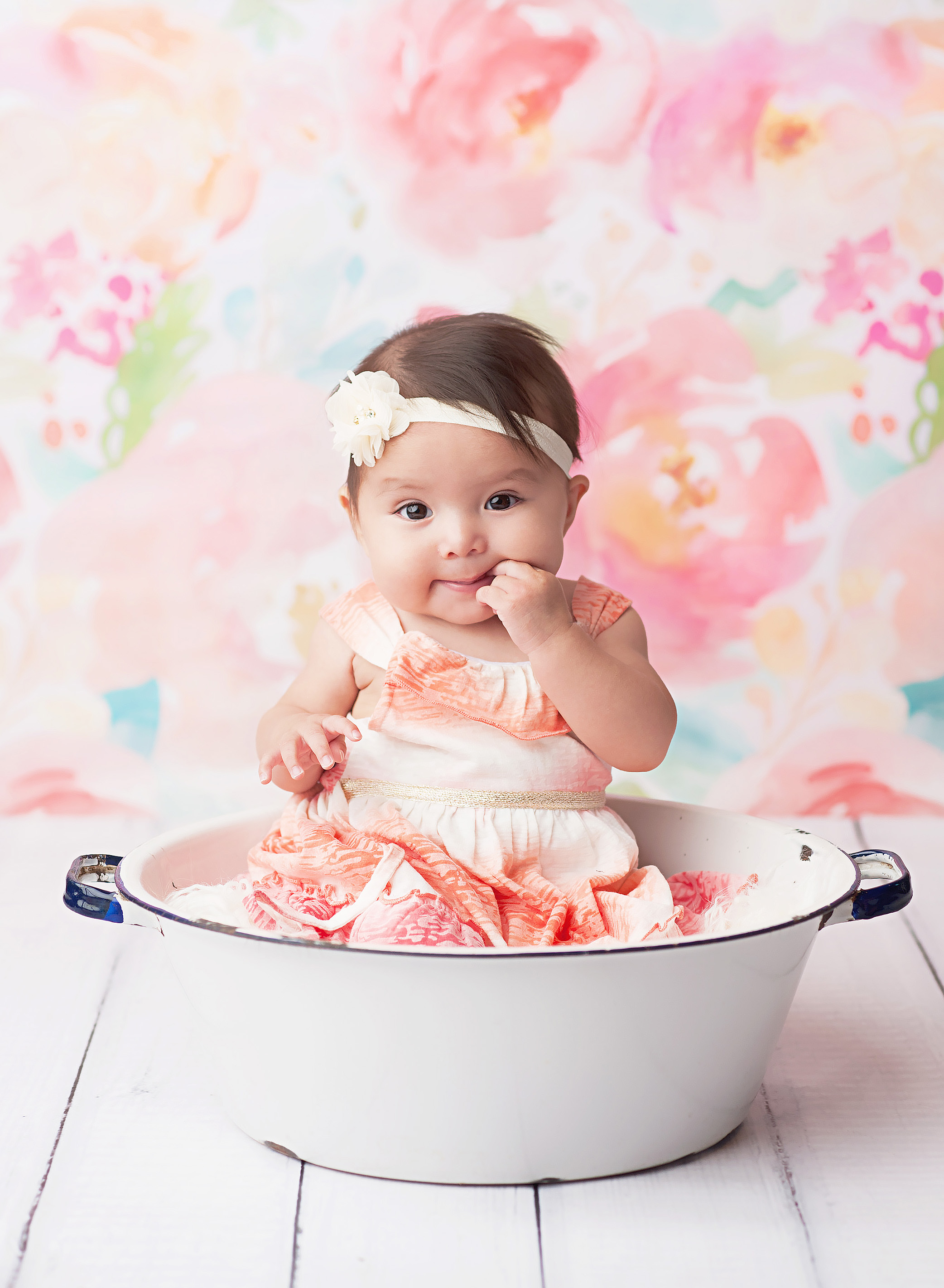6 month old girl in white bowl