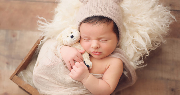newborn boy in teddy bear hat