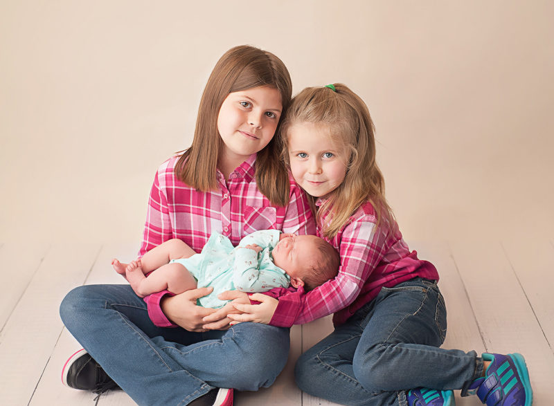 big sisters with baby sister