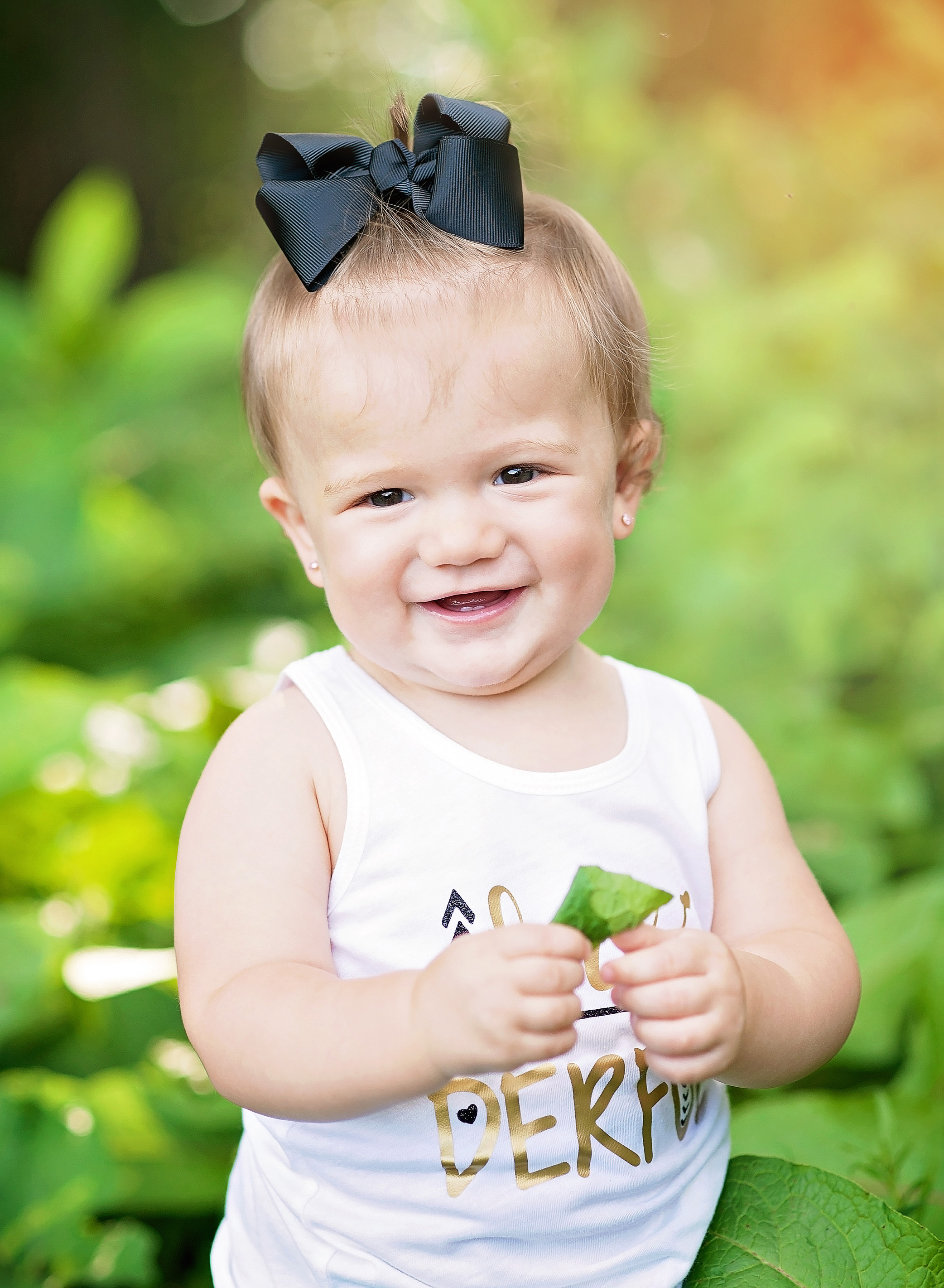 baby girl with black bow