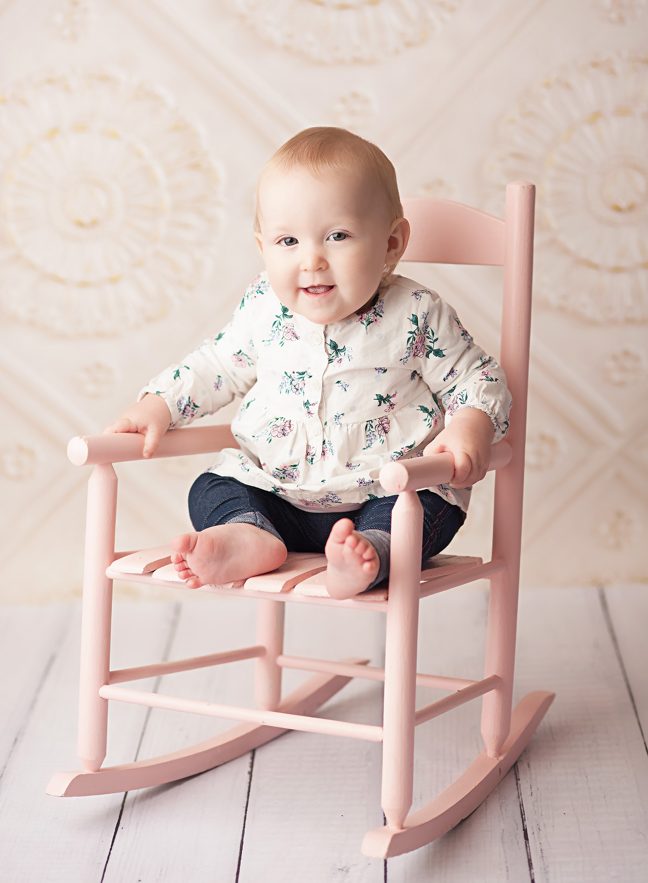 baby in pink rocking chair