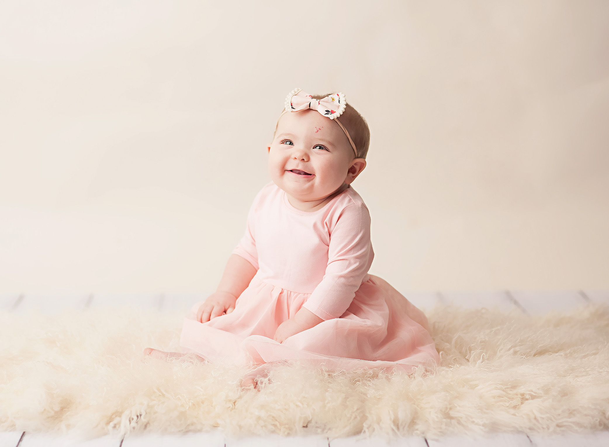 6 month old girl in pink dress