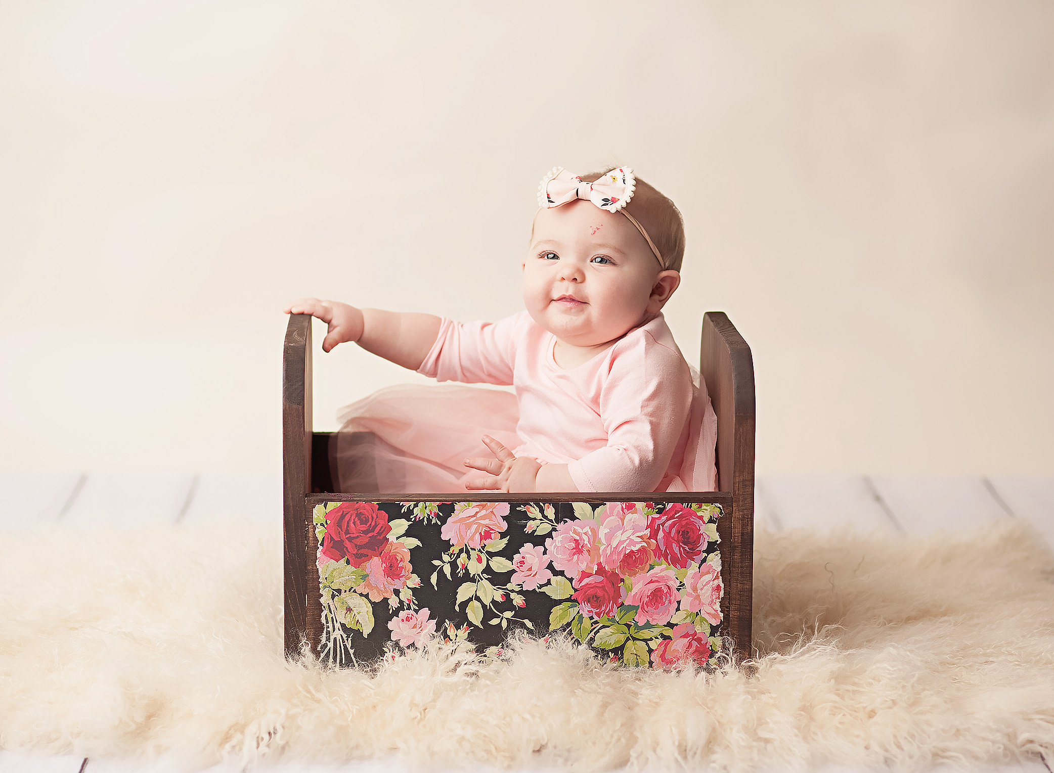 6 month old girl in floral box