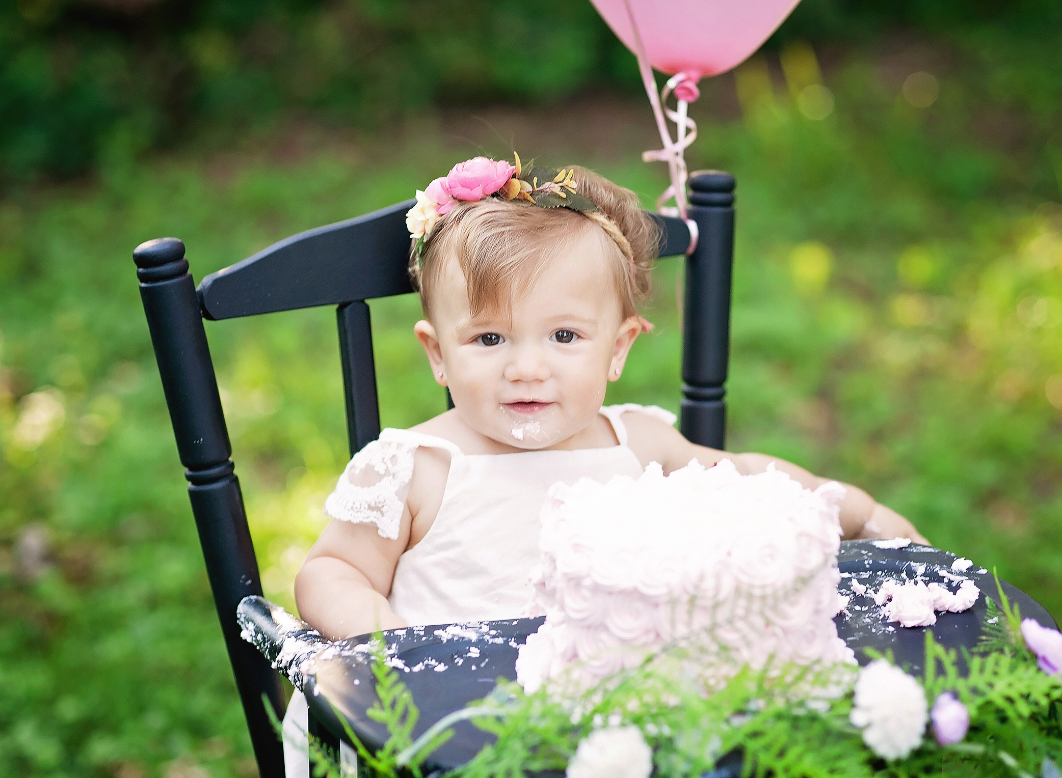 closeup of baby girl in high chair