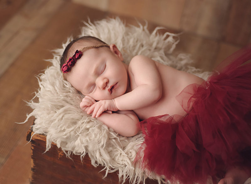 baby with red headband and red tutu